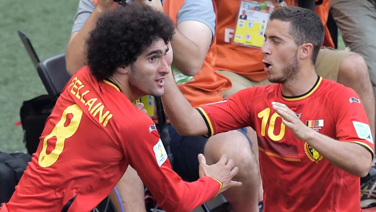 Belgium's midfielder Marouane Fellaini (L) celebrates with Eden Hazard (AFP)