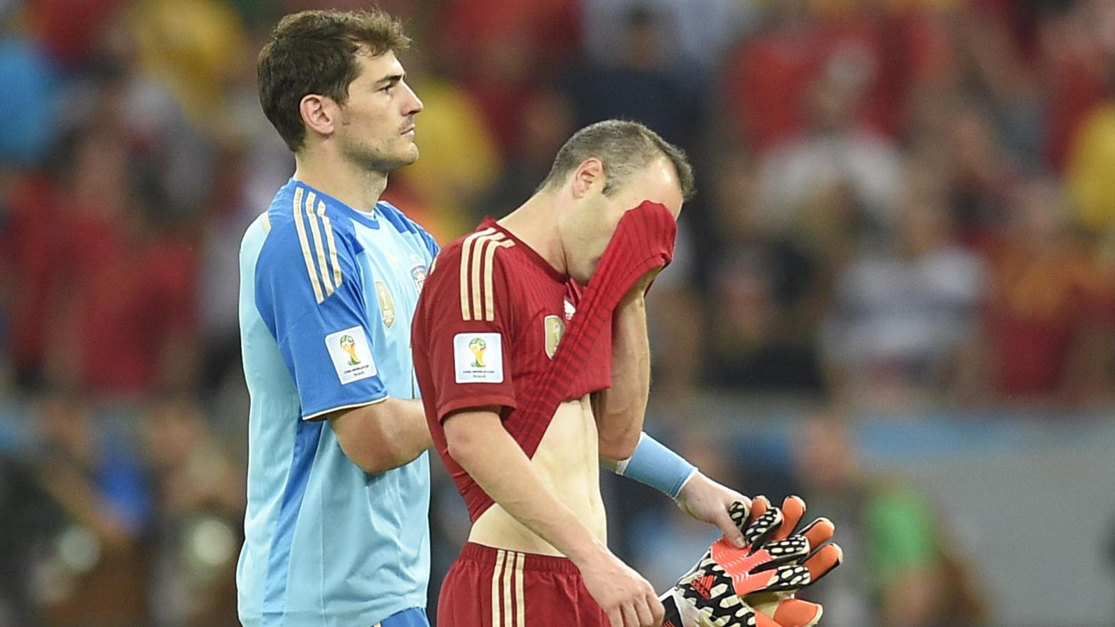 Spain's goalkeeper and captain Iker Casillas and Spain's midfielder Andres Iniesta react after the Group B football match between Spain and Chile in the Maracana Stadium in Rio de Janeiro during the 2014 FIFA World Cup on June 18, 2014.