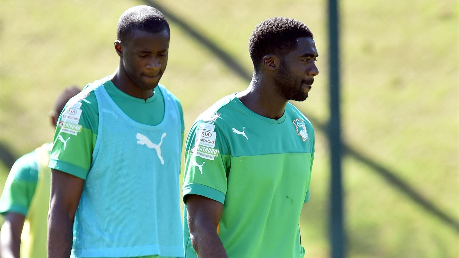 Ivory Coast's midfielder Yaya Toure and Ivory Coast's defender Kolo Toure take part in a training session in Aguas de Lindoia, Brazil