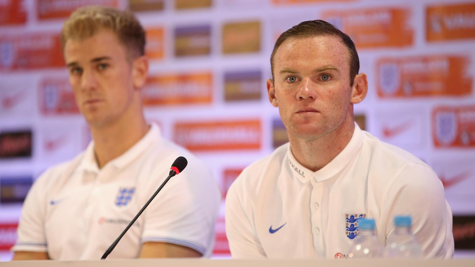Joe Hart and Wayne Rooney faces the media in a press conference after an England training session at the Urca Military Base on June 21, 2014 in Rio de Janeiro, Brazil (Getty)