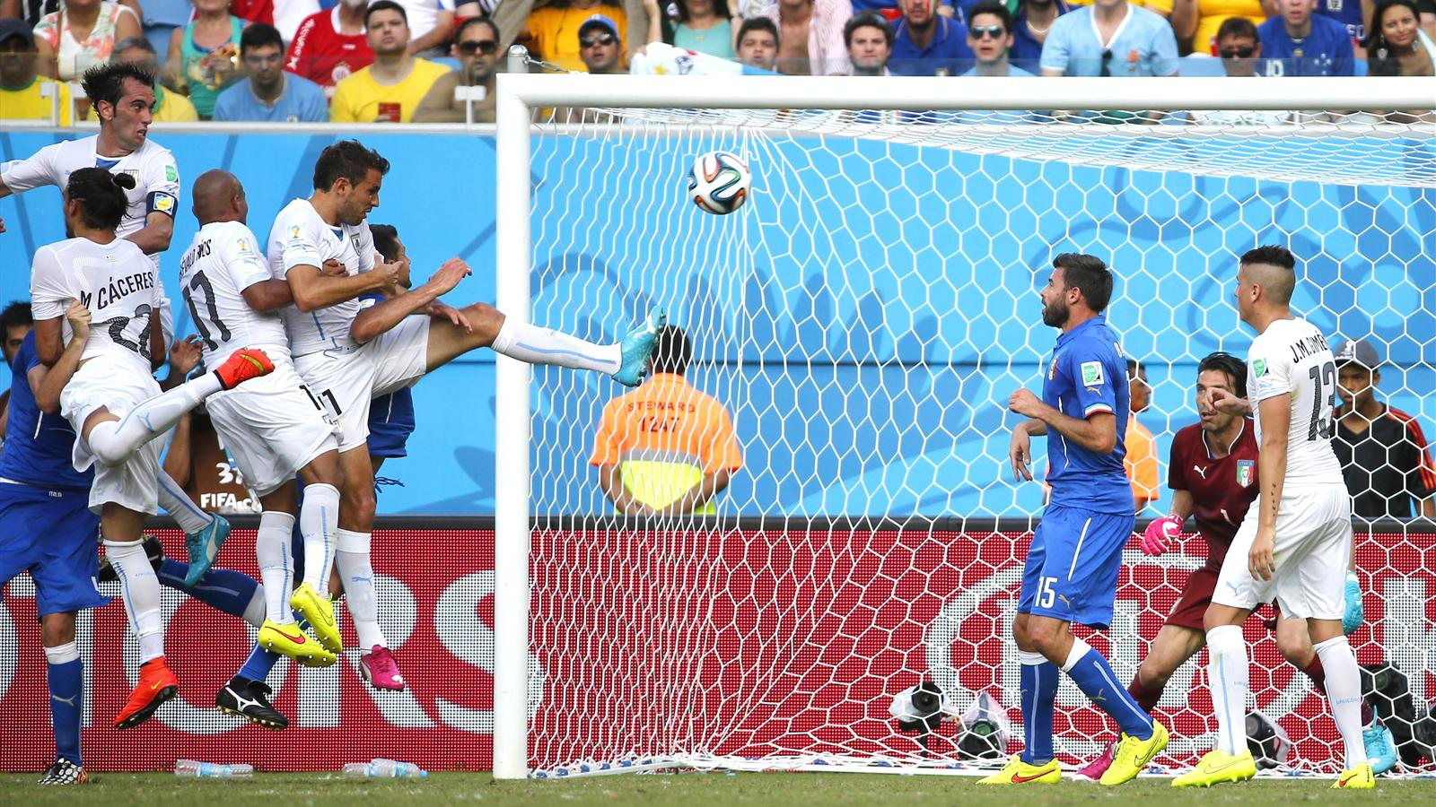 Diego Godin (top left) heads Uruguay's winning goal against italy