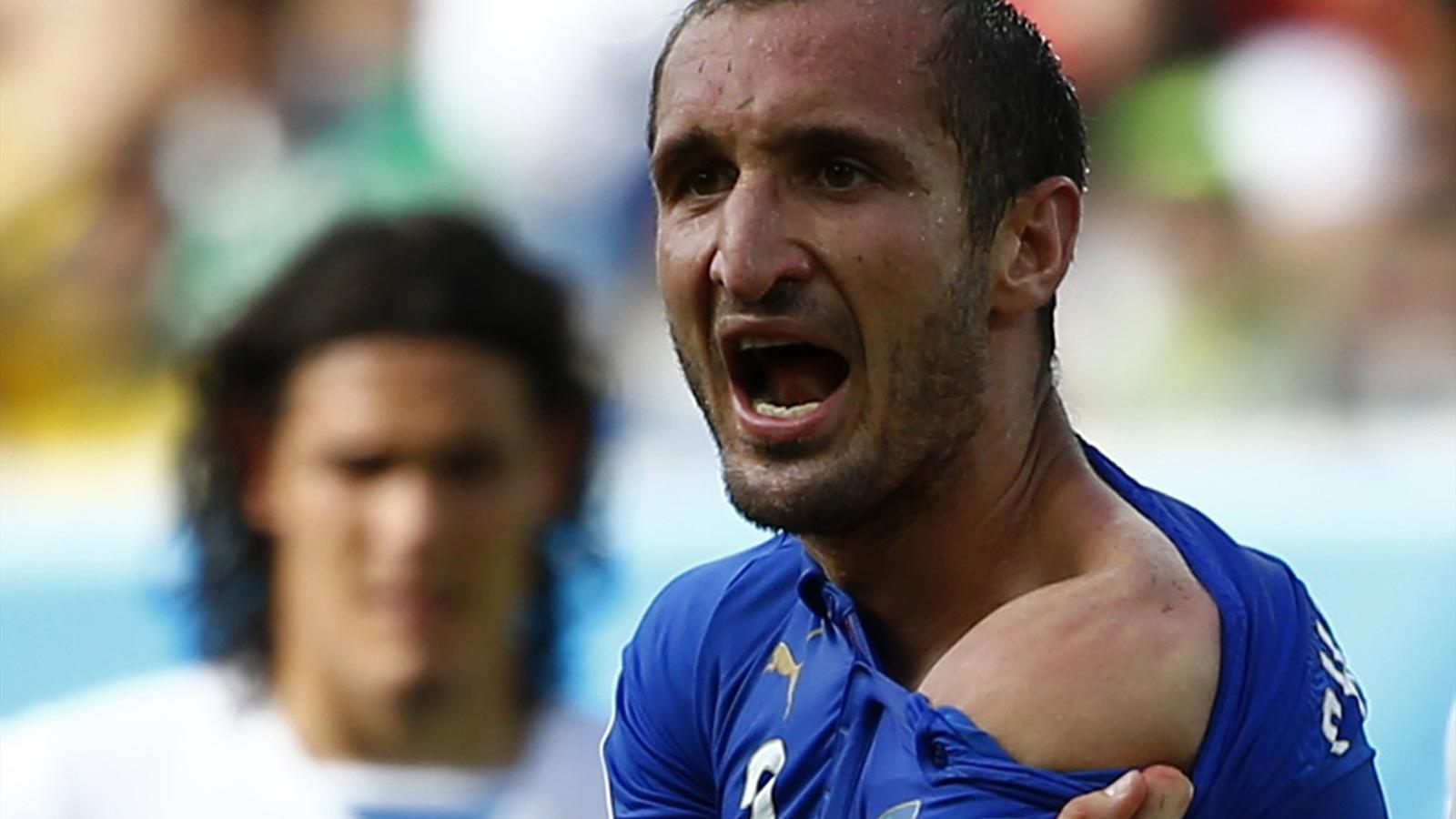 Italy's Giorgio Chiellini shows his shoulder, claiming he was bitten by Uruguay's Luis Suarez (Reuters)