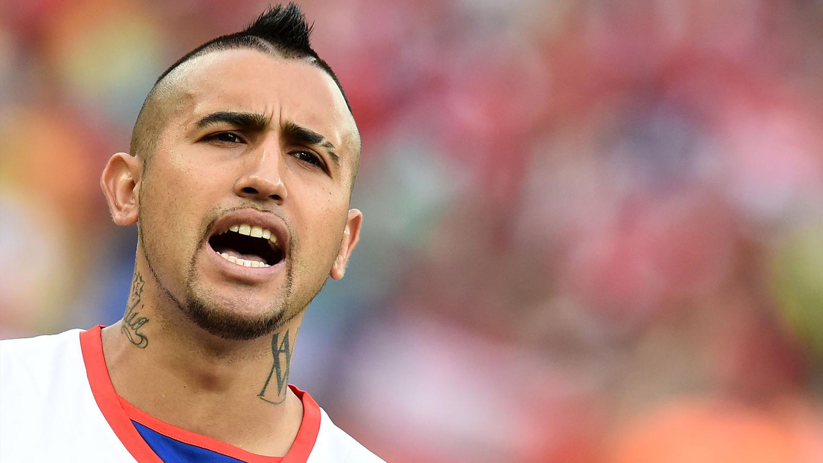 Arturo Vidal during the Chilean hymn in front of Spain