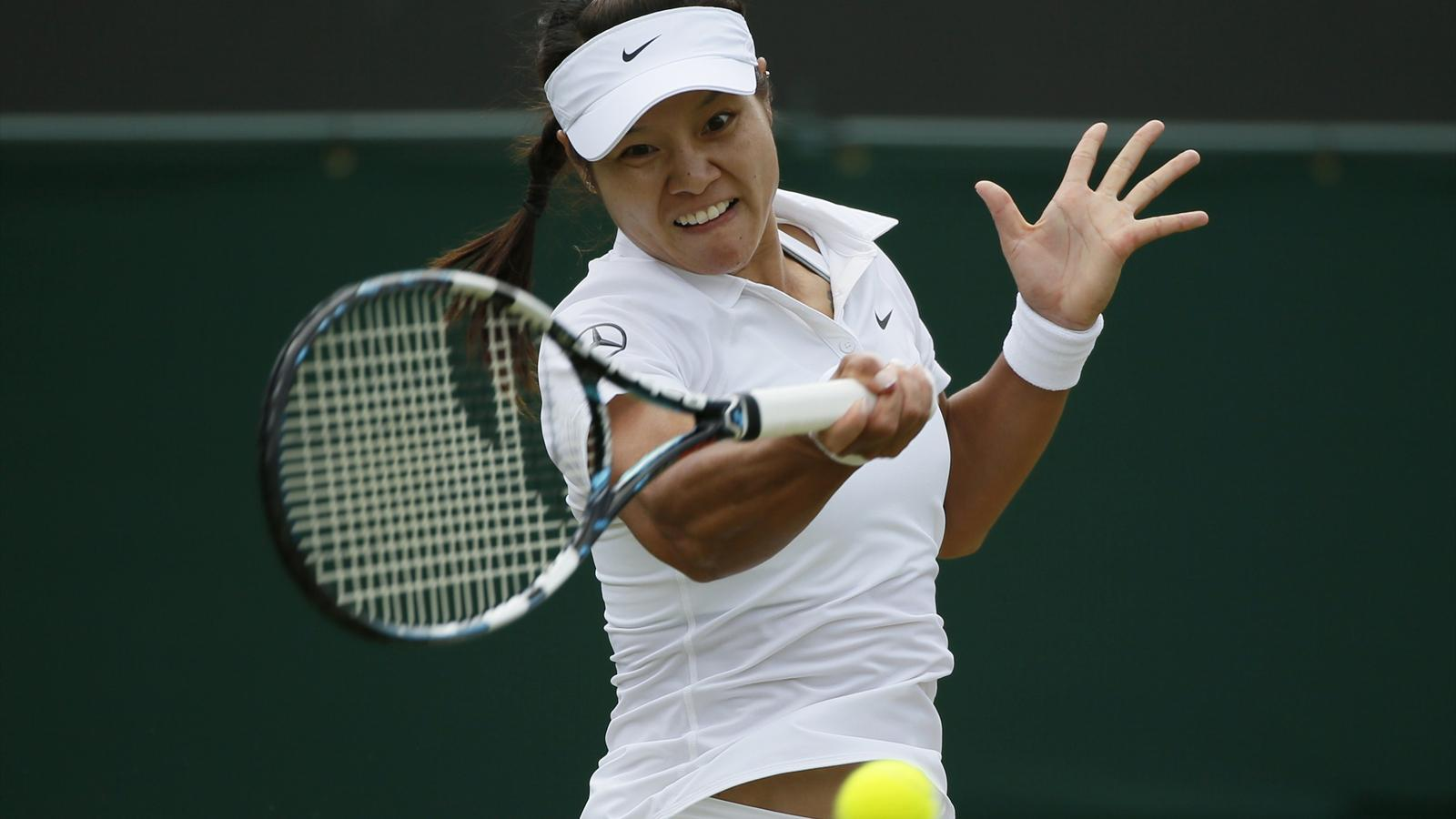 Li Na of China hits a return to Yvonne Meusburger of Austria in their women's singles match at Wimbledon (Reuters)