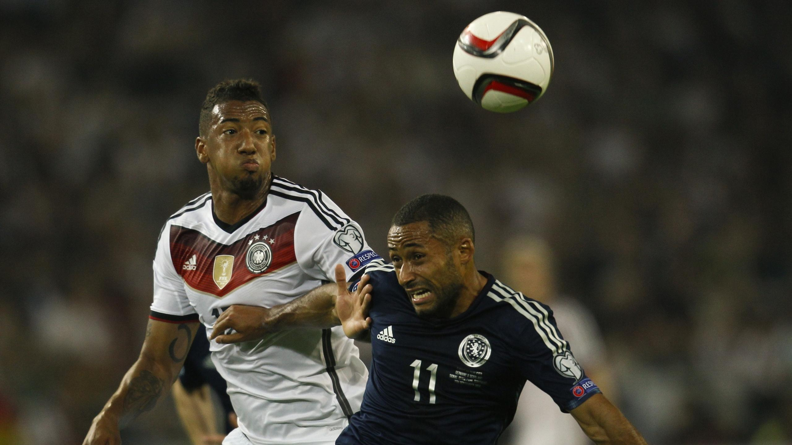 Germany's Jerome Boateng (L) and Scotland's Ikechi Anya fight for the ball during their Euro 2016 qualifying soccer match in Dortmund September 7, 2014 (Reuters)
