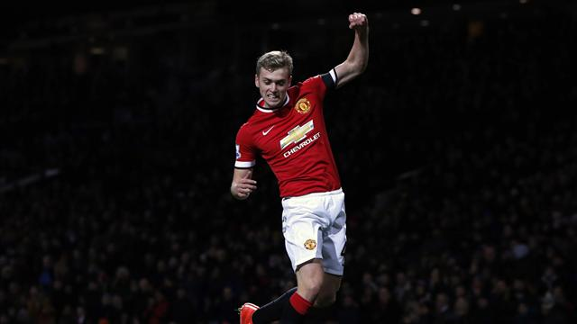 Manchester United's James Wilson celebrates after scoring a goal against Cambridge United during their FA Cup fourth round soccer match at Old Trafford in Manchester, northern England February 3, 2015 (Reuters)