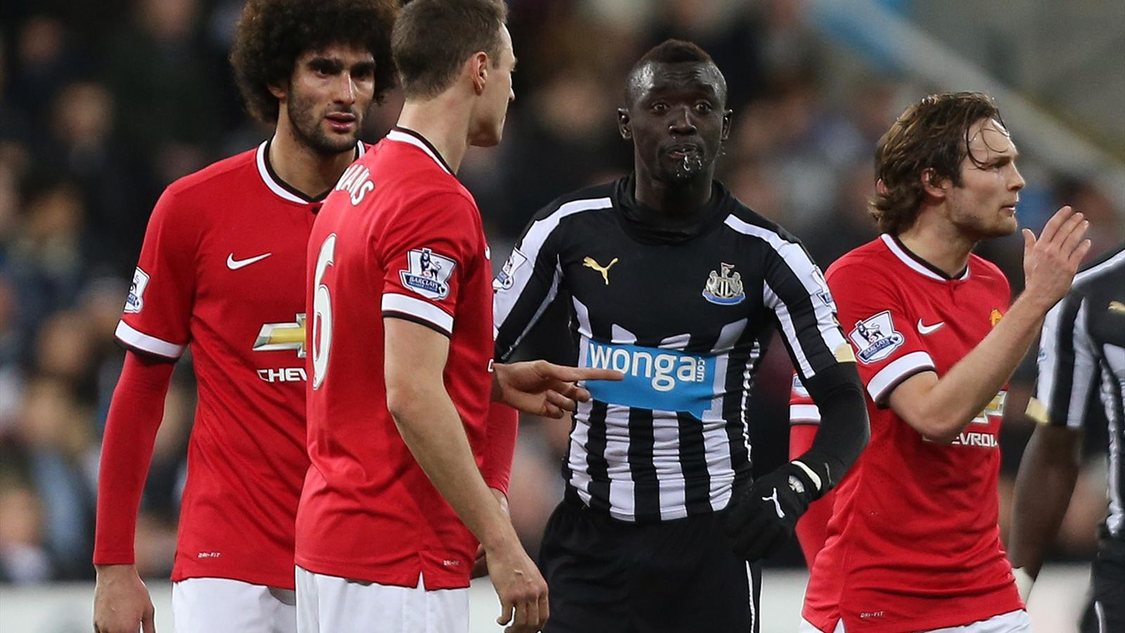 Manchester United's Jonny Evans clashes with Newcastle's Papiss Cisse as Cisse spits (Reuters)