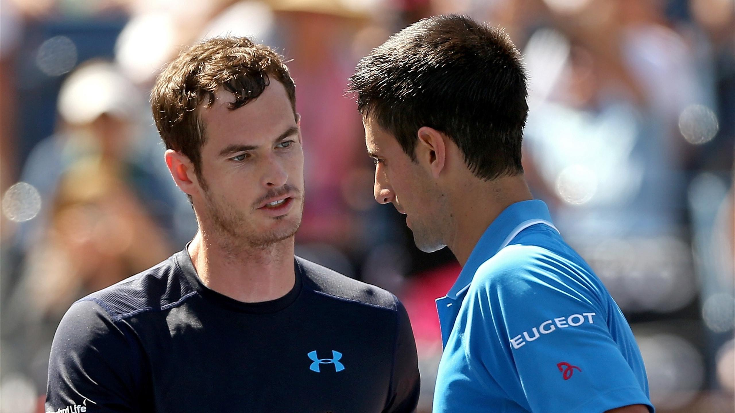 Andy Murray of Great Britain congratulates Novak Djokovic of Serbia