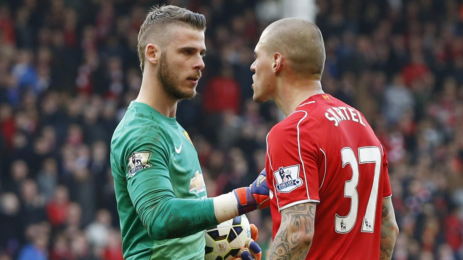 Liverpool's Martin Skrtel clashes with Manchester United's David De Gea (Reuters)