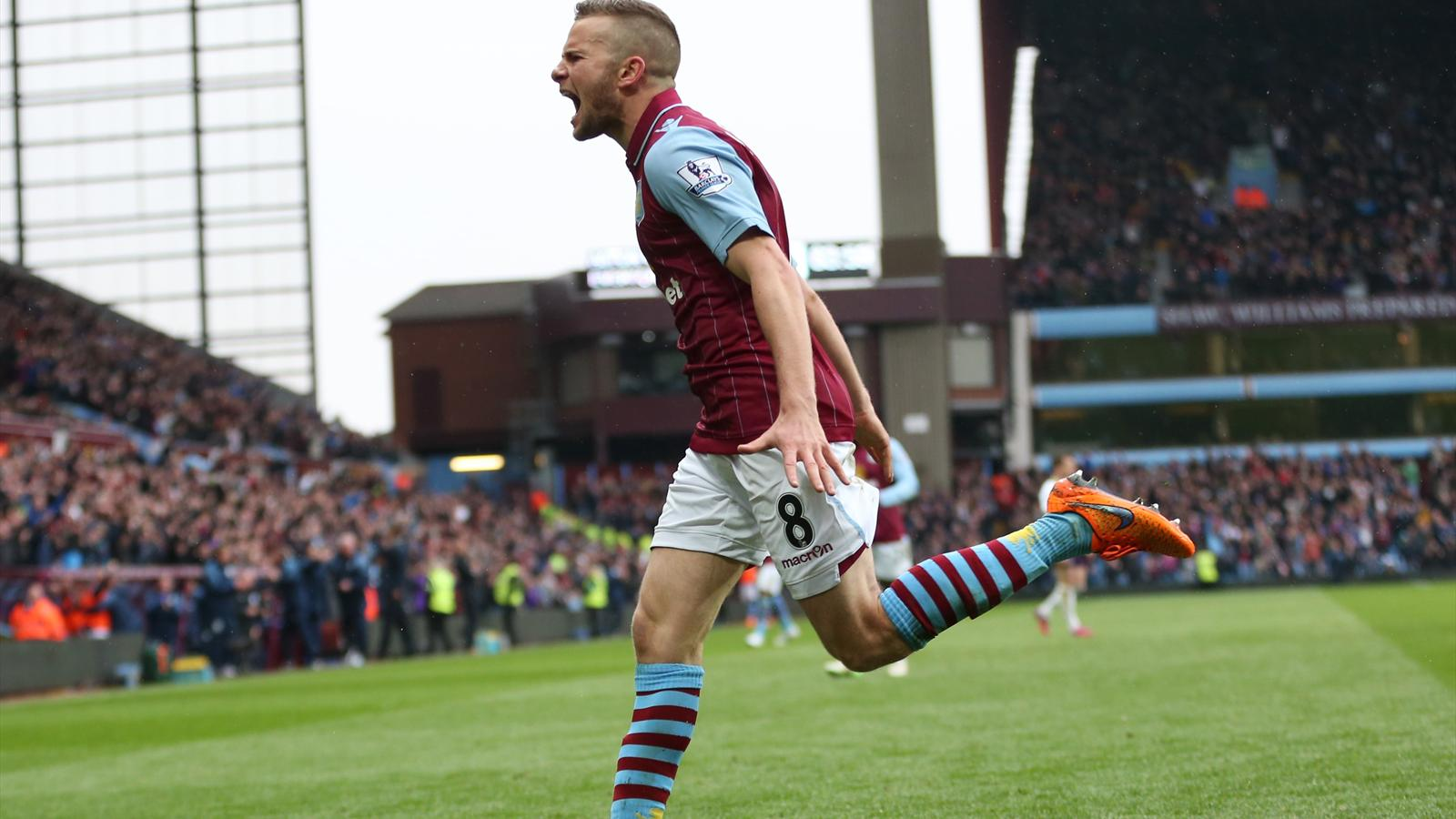 Tom Cleverley roars his celebration