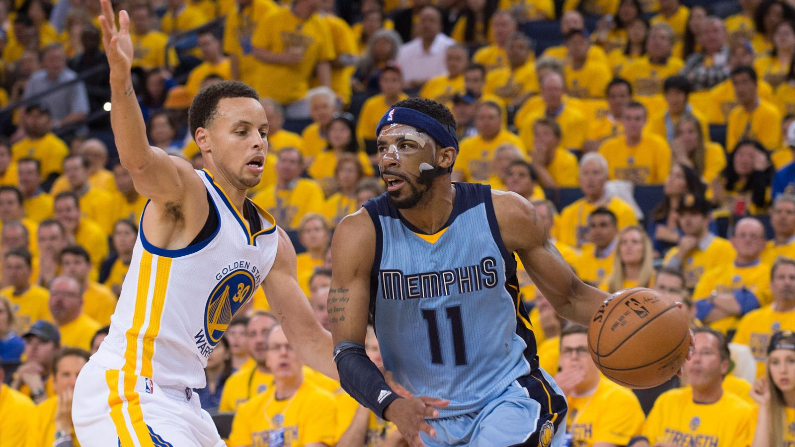 A; Memphis Grizzlies guard Mike Conley (11) dribbles the basketball against Golden State Warriors guard Stephen Curry (30) during the third quarter in game two of the second round of the NBA Playoffs at Oracle Arena (Reuters)