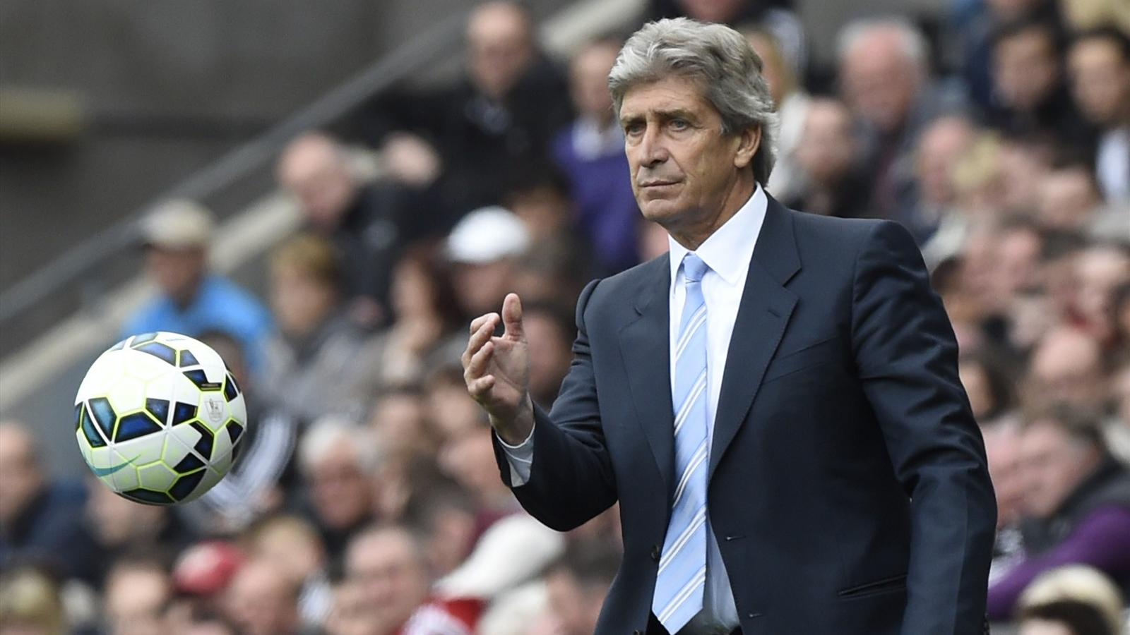 Manchester City manager Manuel Pellegrini throws the ball back into play