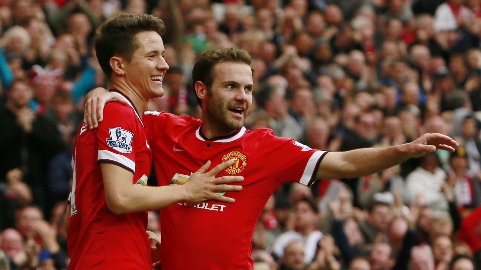 Ander Herrera celebrates with Juan Mata after scoring for Manchester United