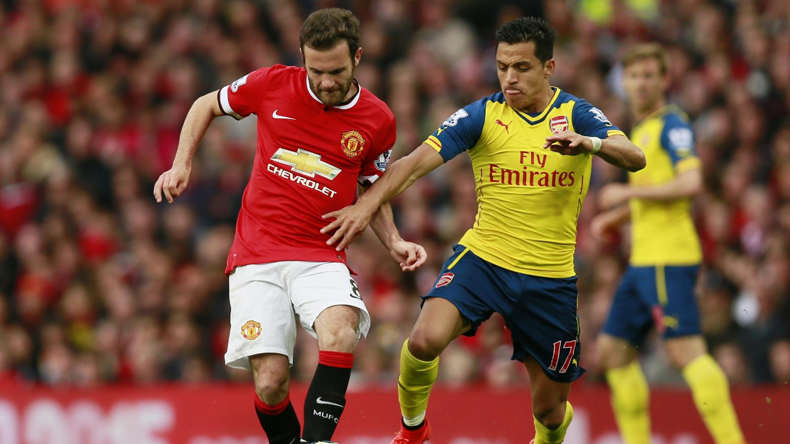 Arsenal's Alexis Sanchez in action with Manchester United's Juan Mata