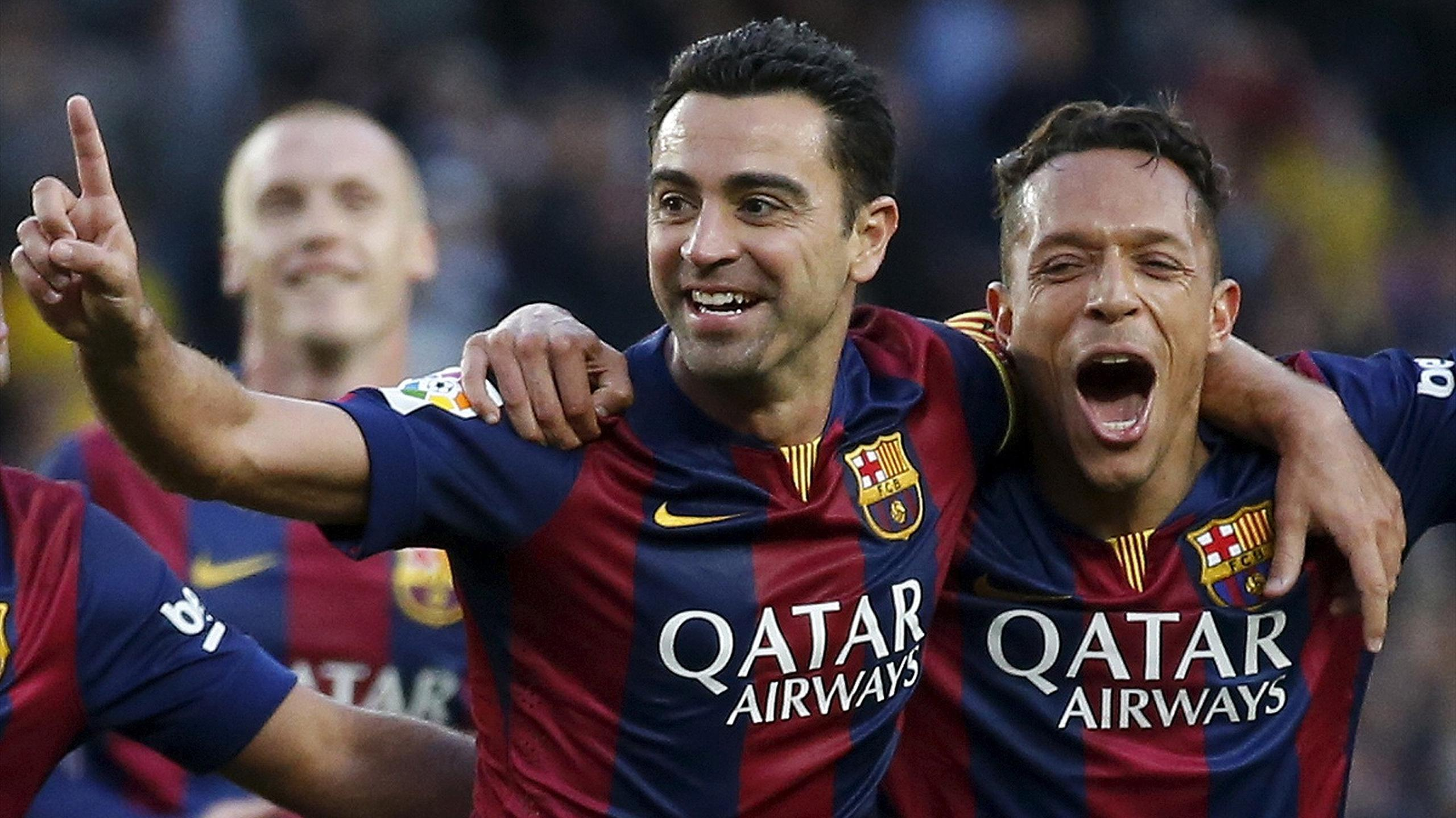 Barcelona's Xavi Hernandez (L) celebrates his goal against Getafe with teammate Adriano during their Spanish first division soccer match at Nou Camp stadium in Barcelona