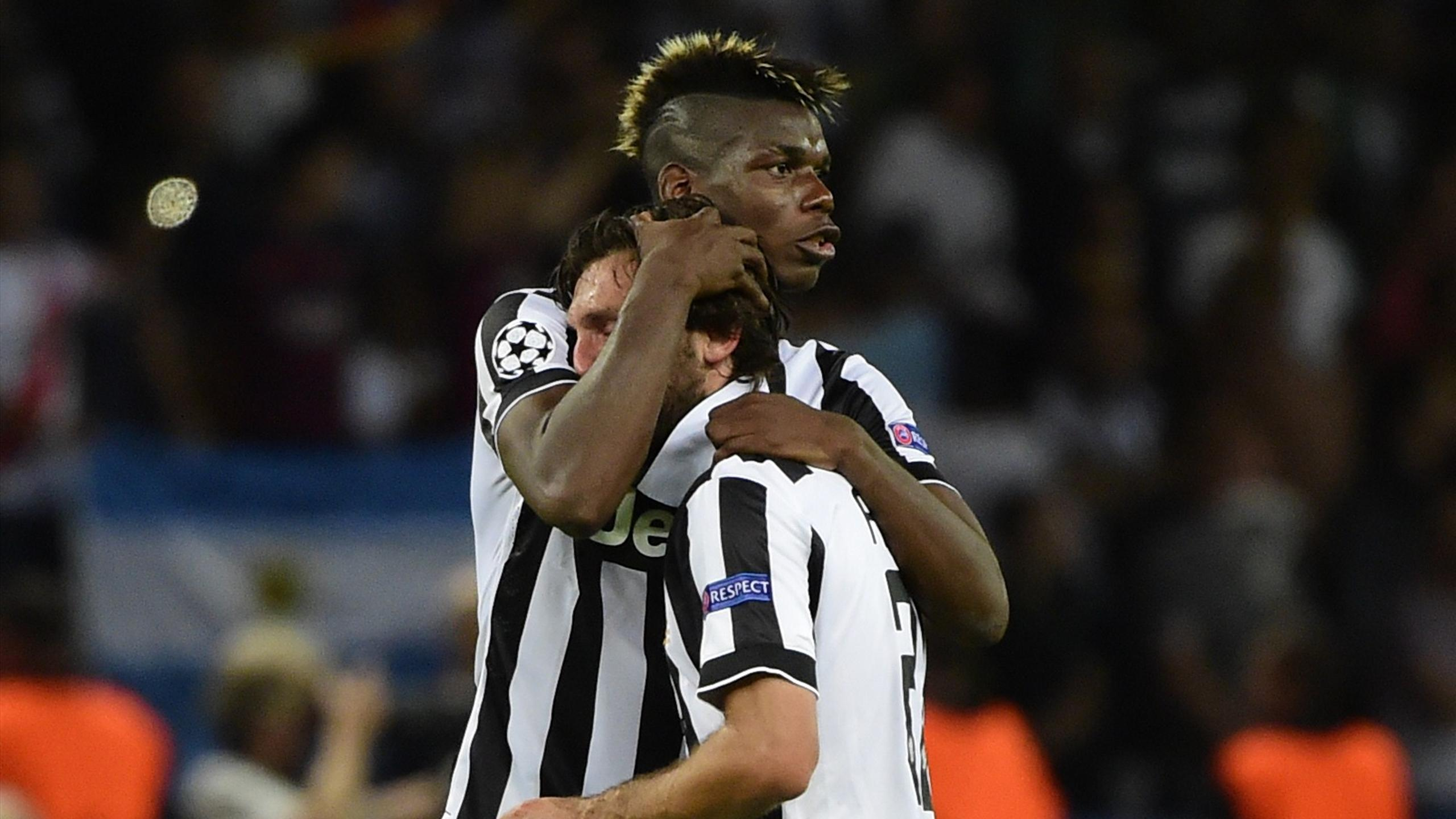 Paul Pogba and Andrea Pirlo console each other after Juventus lose to Barcelona