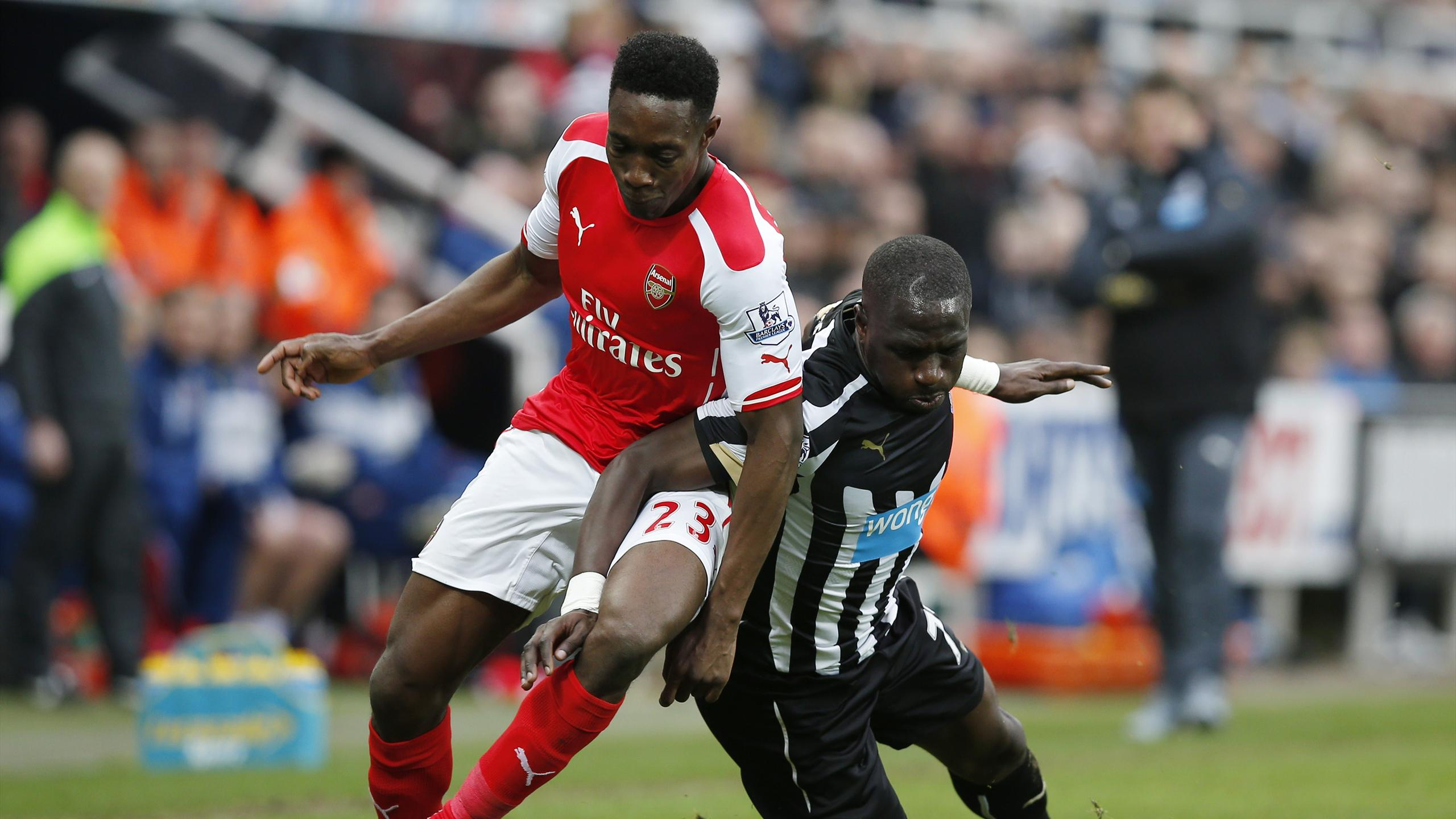 Arsenal's Danny Welbeck in action with Newcastle's Moussa Sissoko