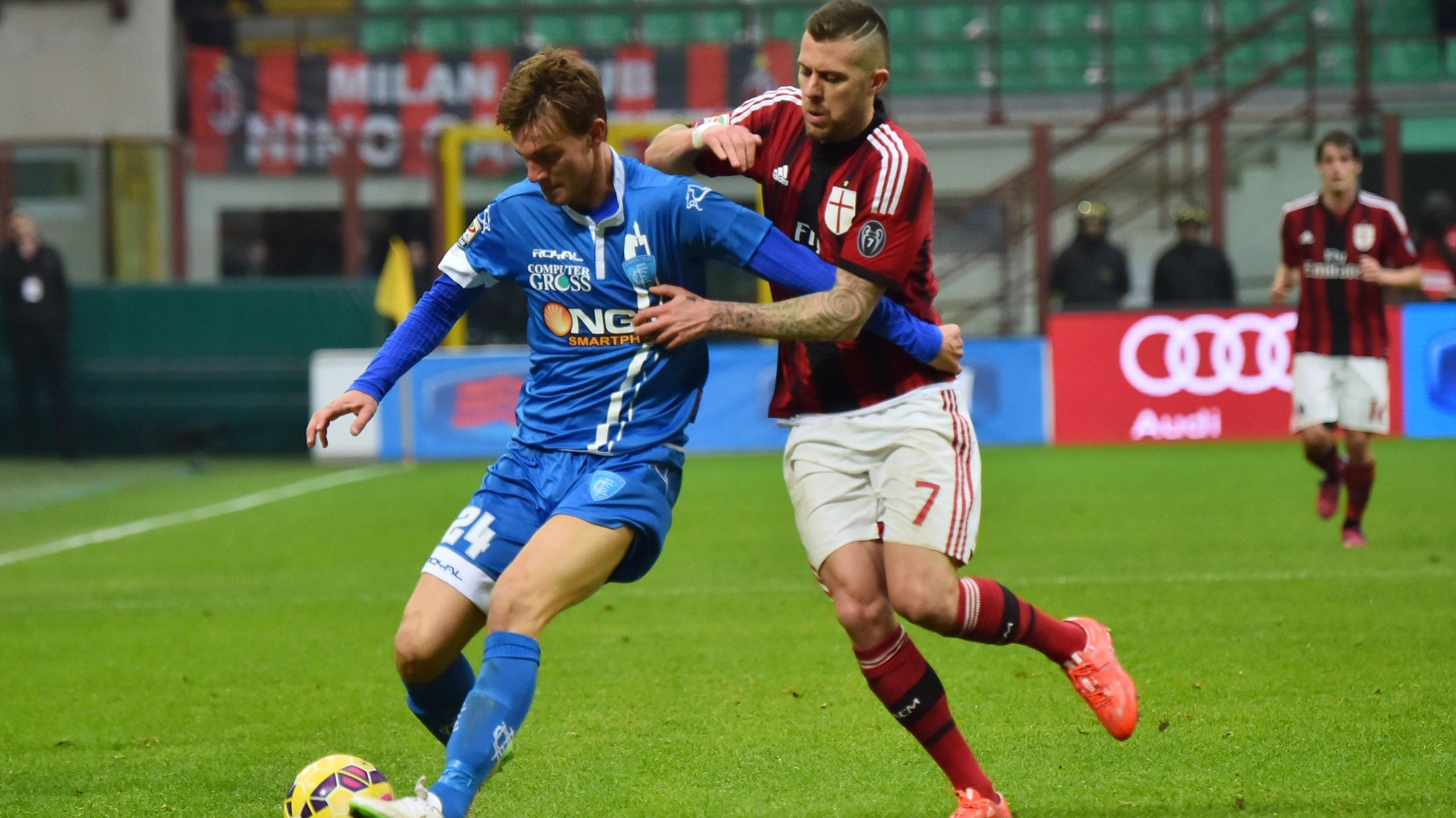 AC Milan's midfielder from France Jeremy Menez (R) fights for the ball with Empoli's defender Daniele Rugani