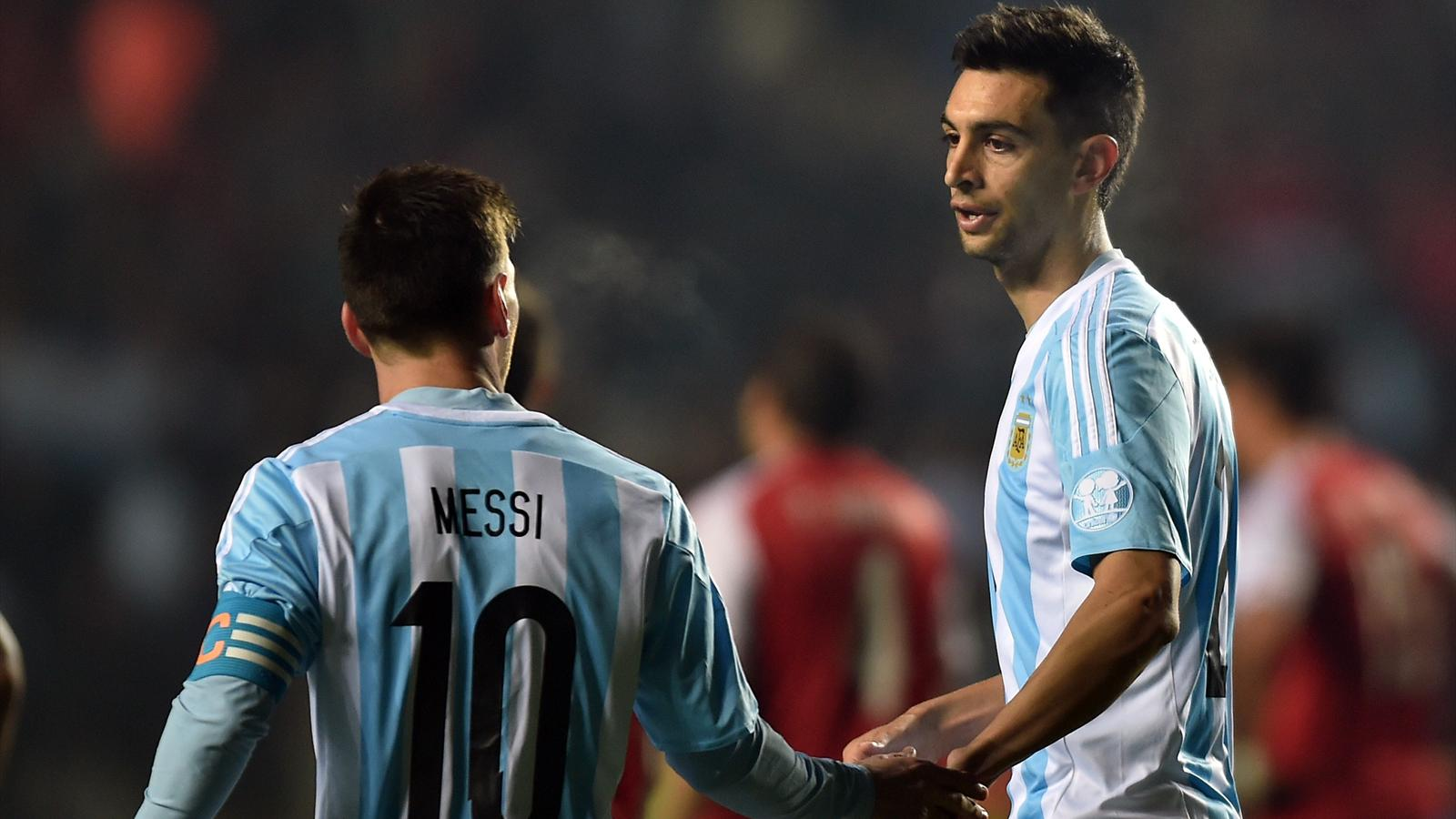 Argentina's midfielder Javier Pastore (R) celebrates with teammate Lionel Messi after scoring against Paraguay during their Copa America semi-final football match in Concepcion, Chile