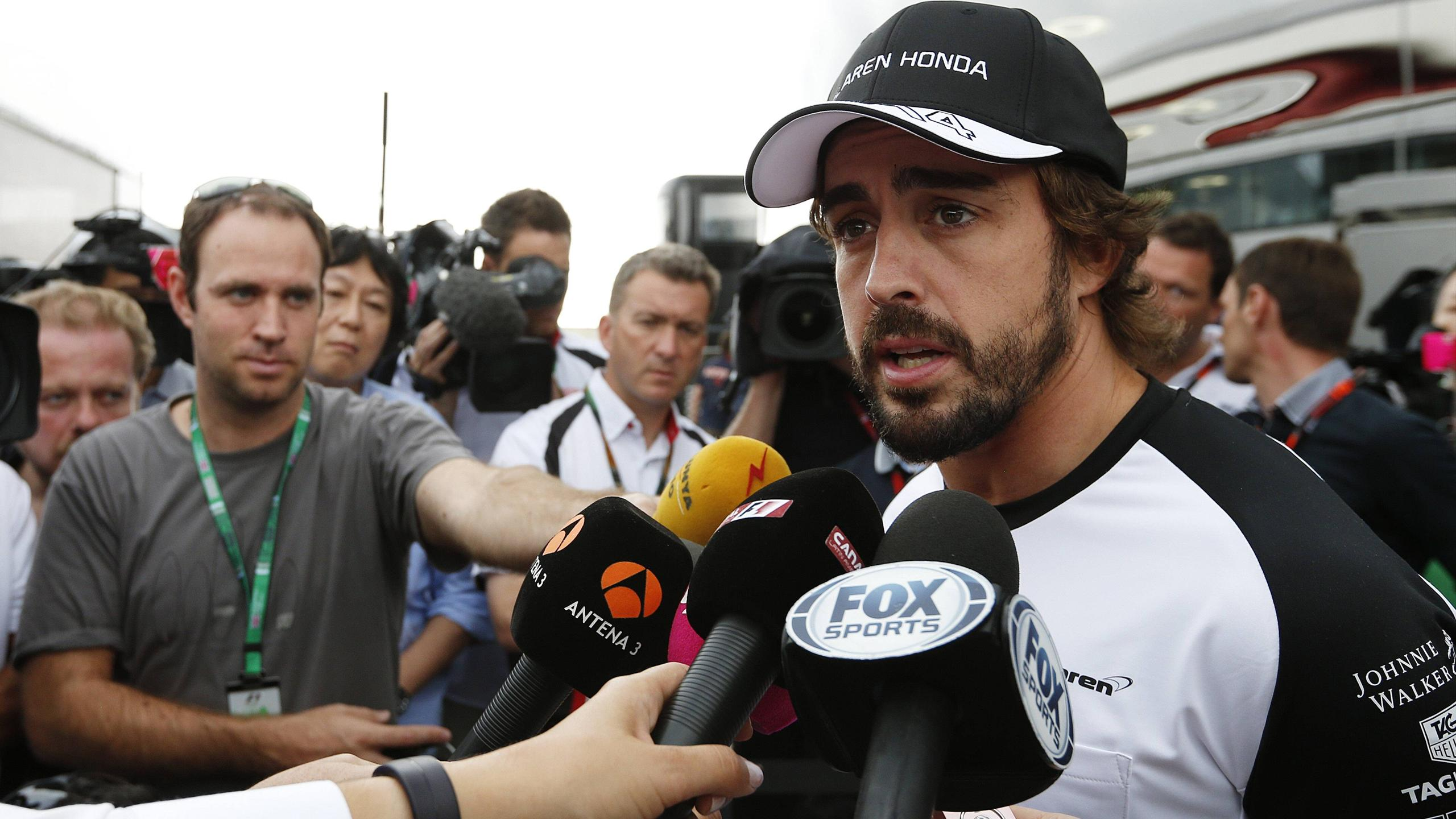 McLaren driver Fernando Alonso speaks to the press at Silverstone