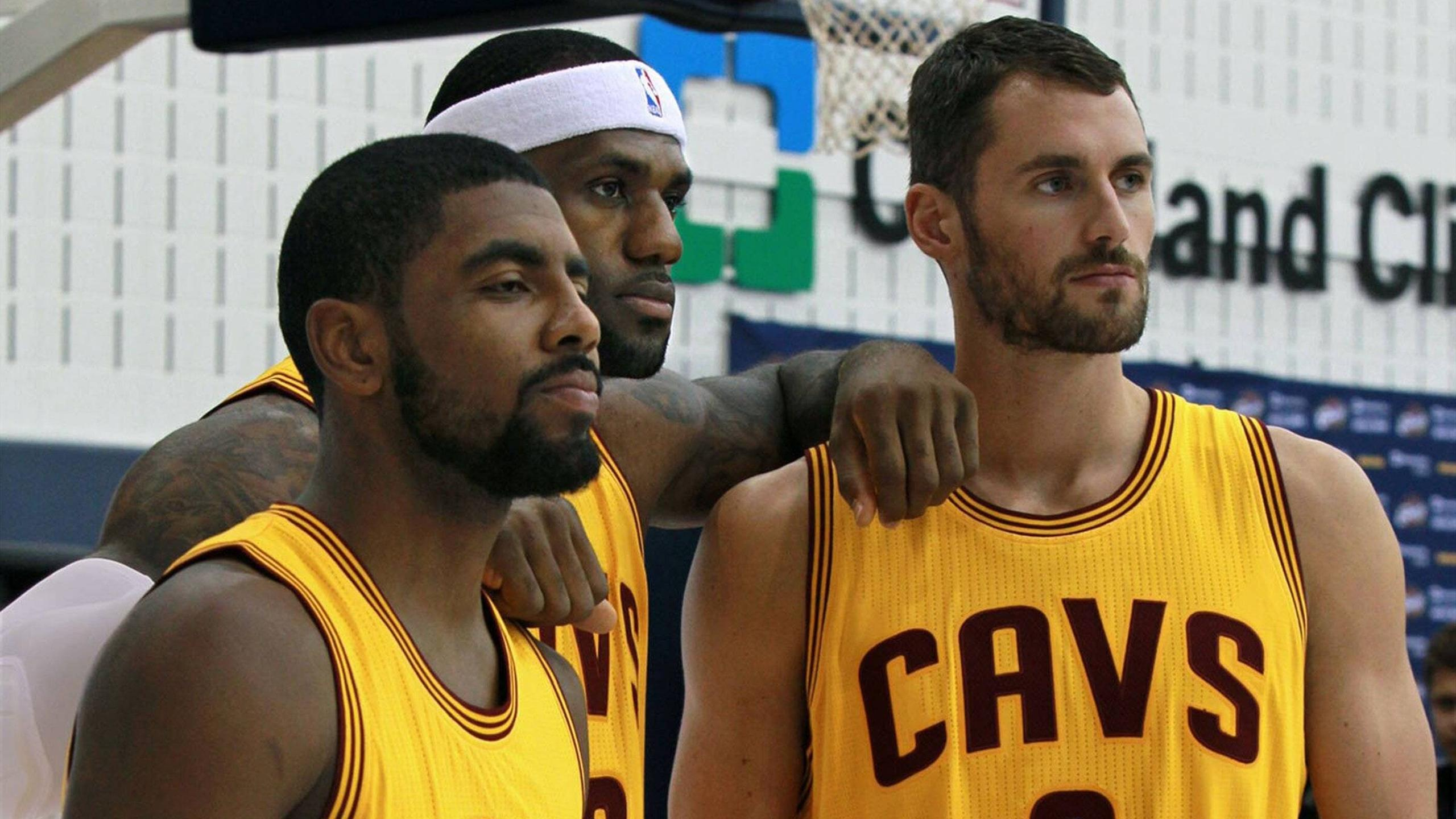 Kyrie Irving (L), LeBron James and Kevin Love (R) pose for the Cleveland Cavaliers media day