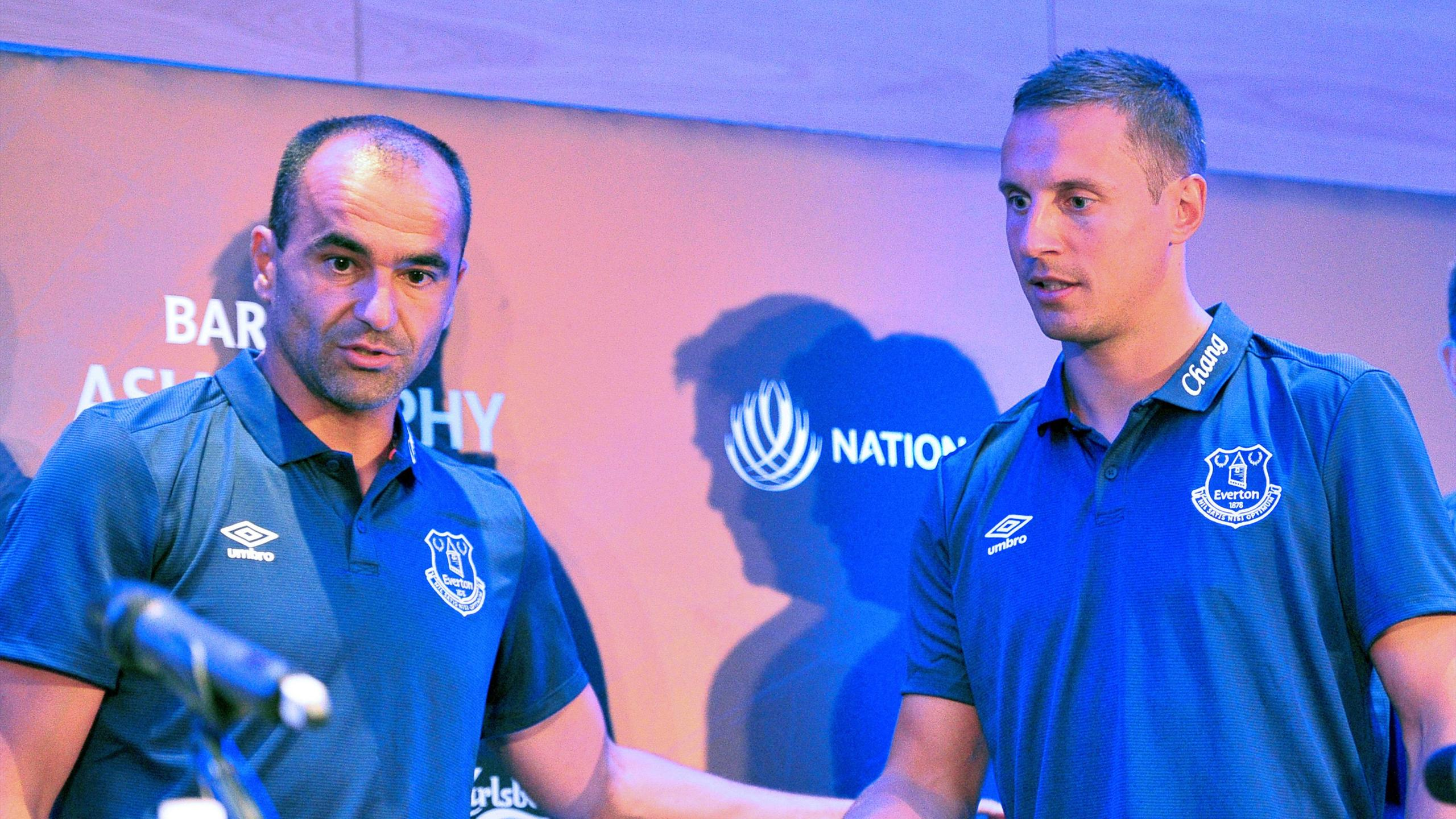 Everton manager Roberto Martinez (L) and club captain Phil Jagielka (R) attend a press conference in Singapore
