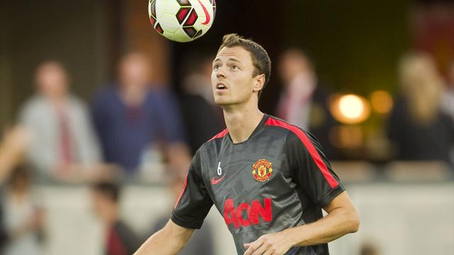 Manchester United's Jonny Evans warms up