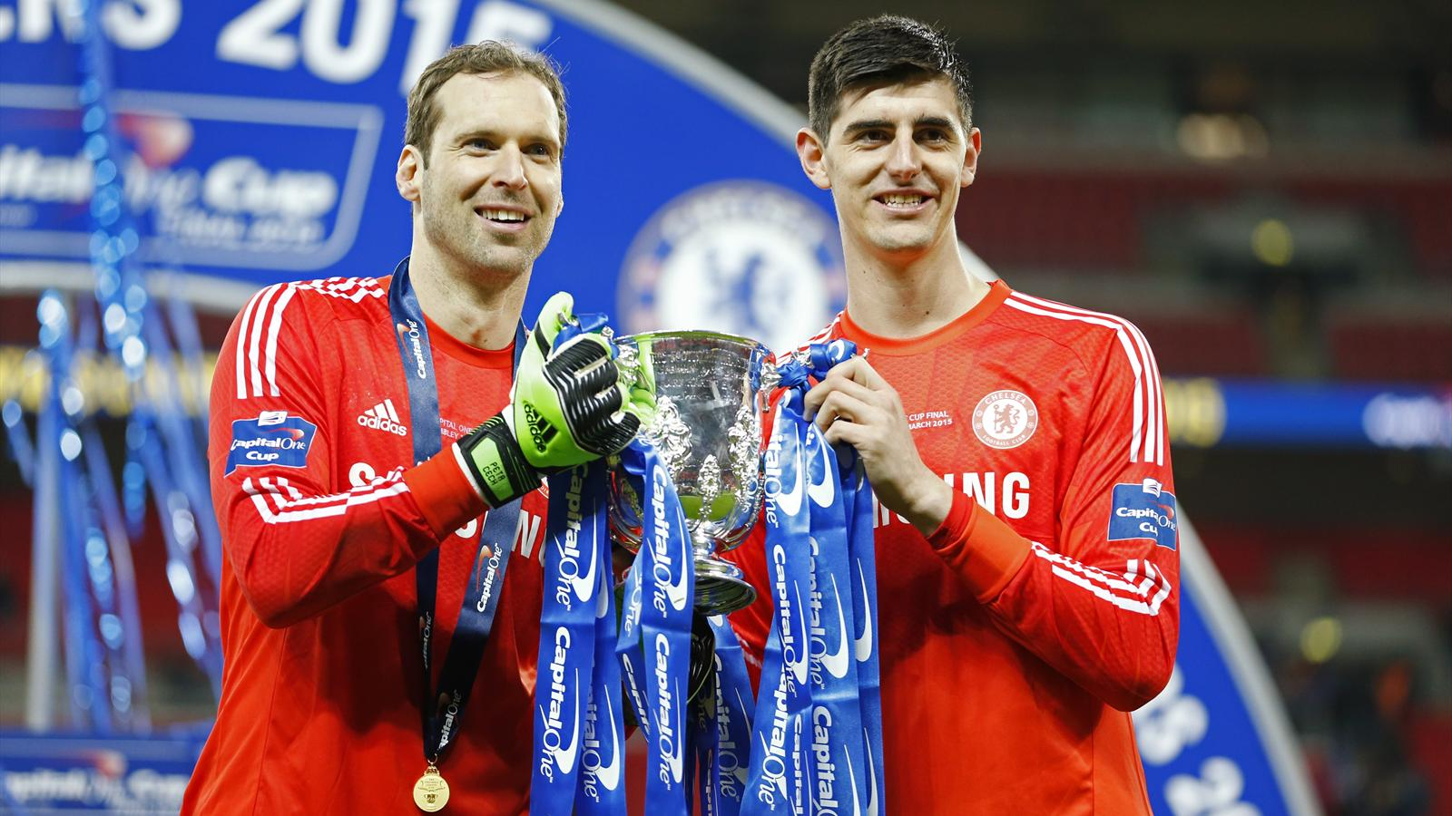 Petr Cech celebrates winning the League Cup with former team-mate Thibaut Courtois while at Chelsea