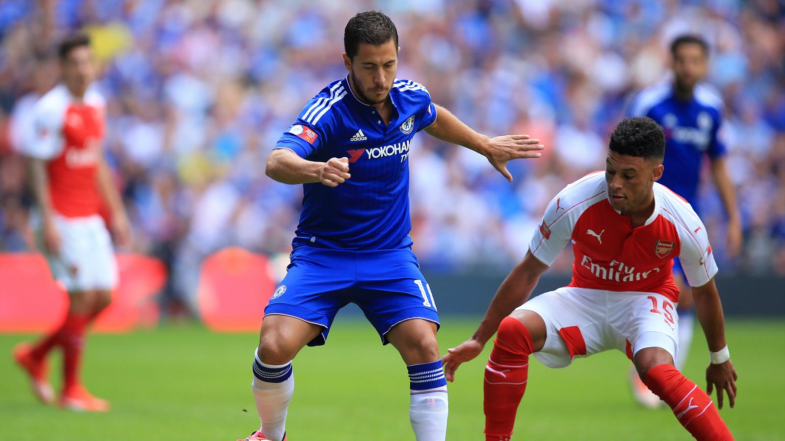 Chelsea's Eden Hazard (left) and Arsenal's Alex Oxlade-Chamberlain battle for the ball.