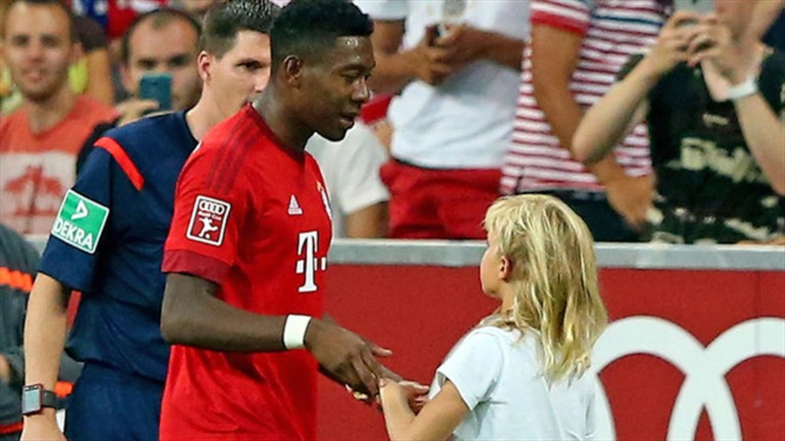 Bayern Munich's David Alaba escorts girl back to her seat
