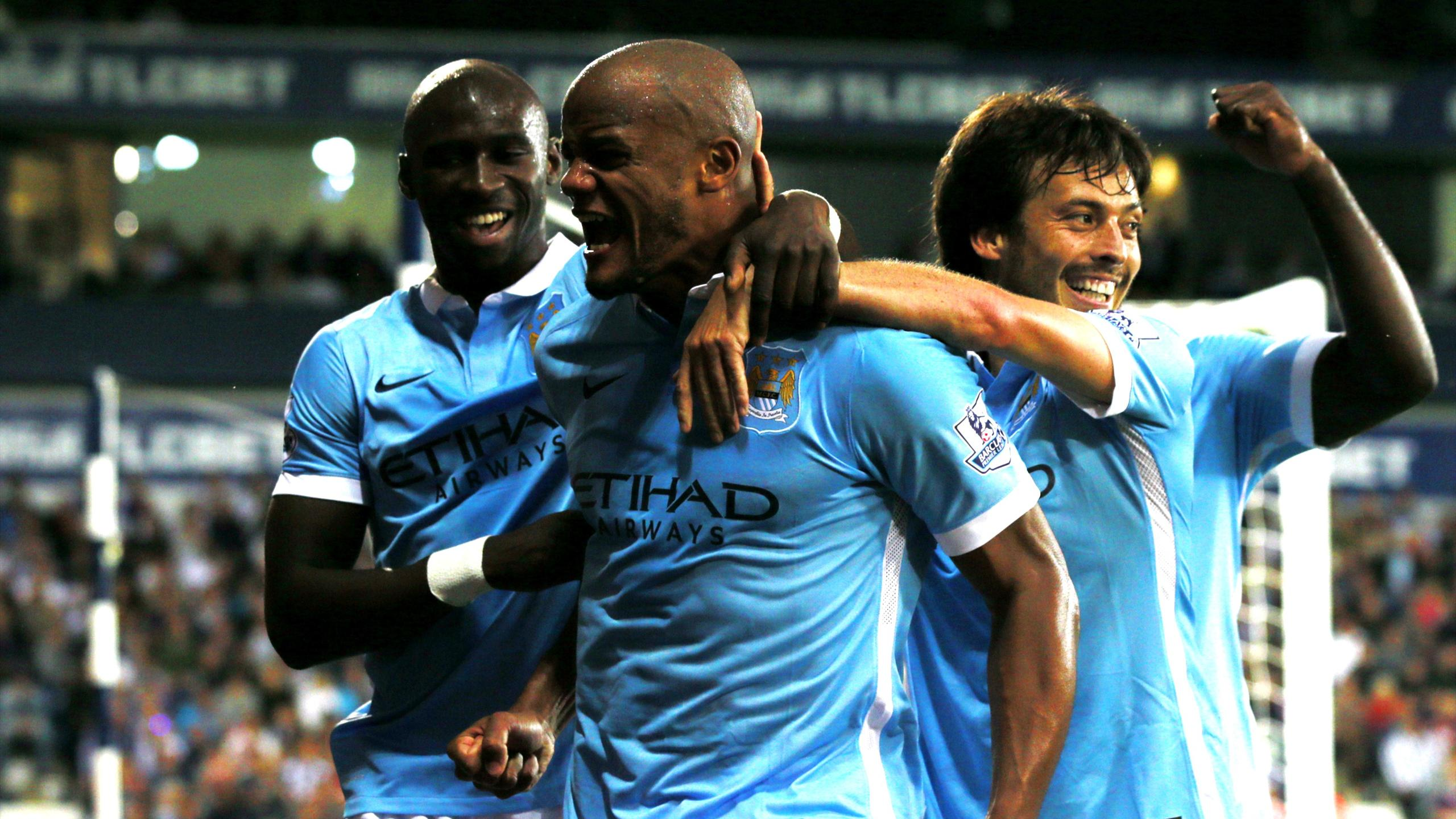 Vincent Kompany celebrates with team-mates after scoring the third goal for Manchester City against West Brom