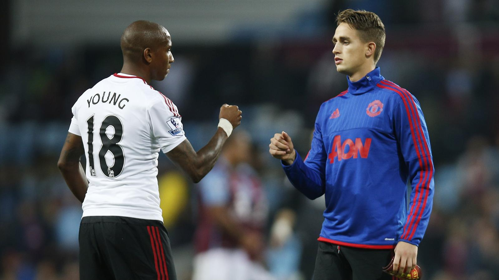Adnan Januzaj bumps fists with Ashley Young