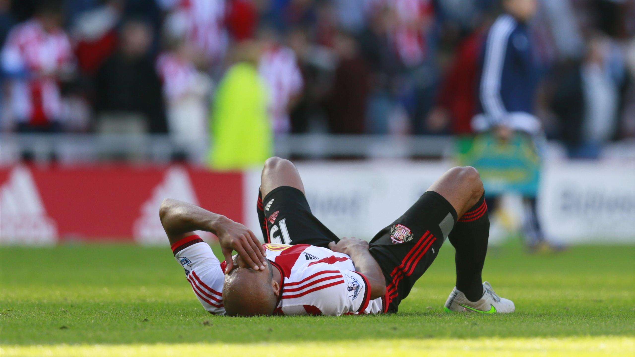 Sunderland's Younes Kaboul lies on the floor in pain
