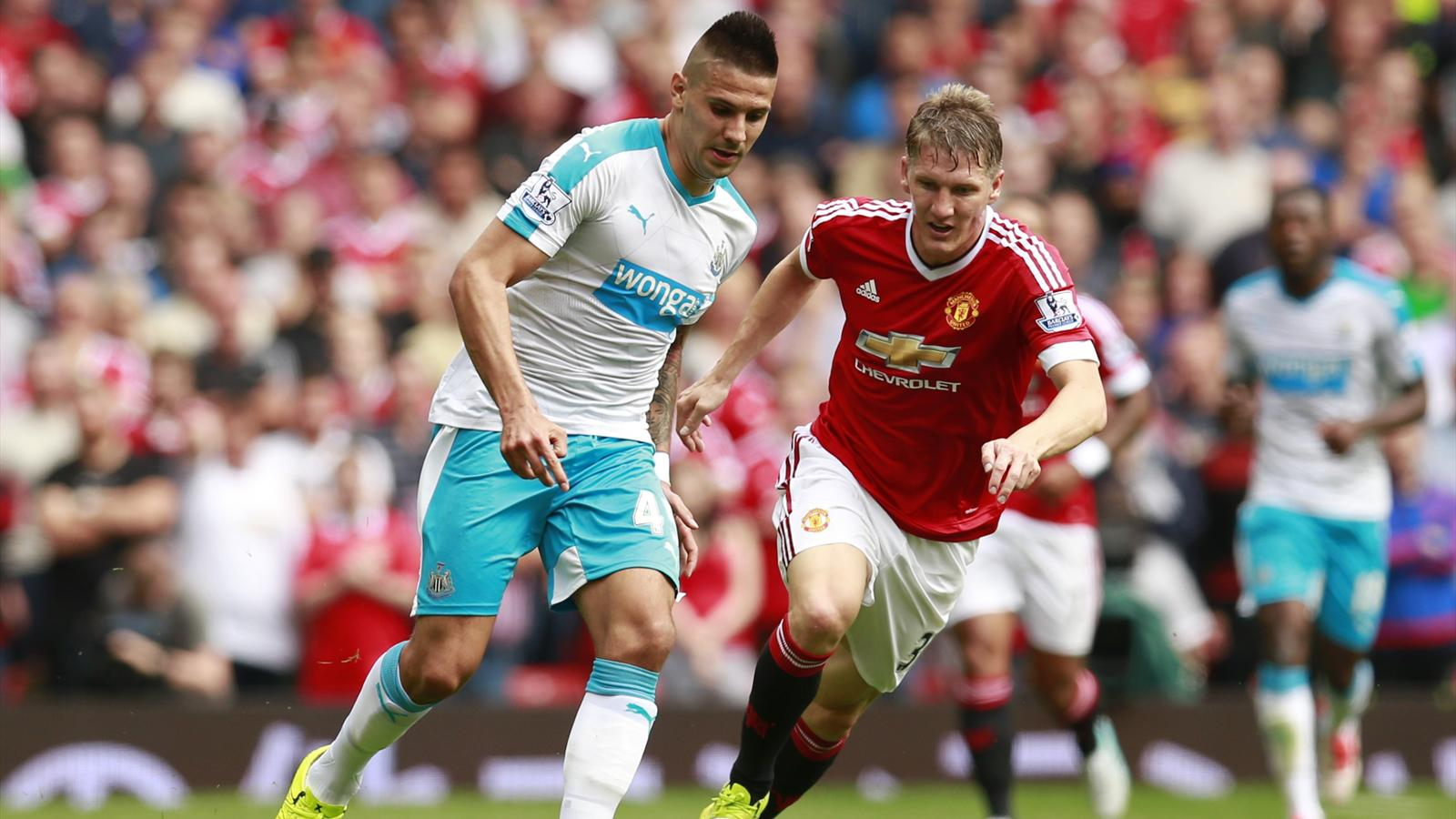 Manchester United's Bastian Schweinsteiger in action with Newcastle United's Aleksandar Mitrovic
