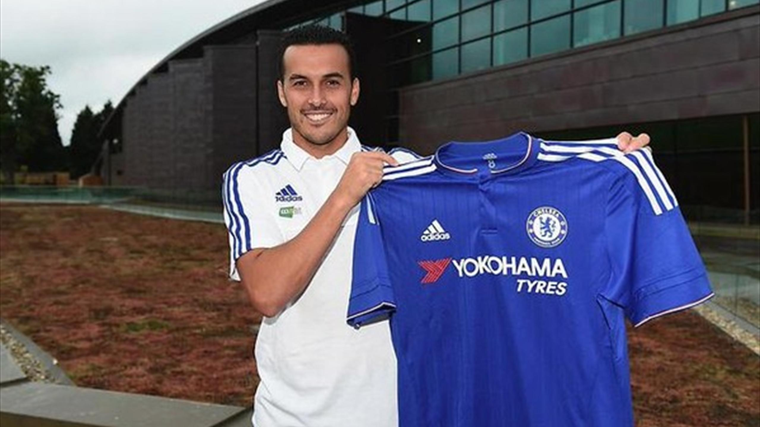New Chelsea signing Pedro poses with his shirt