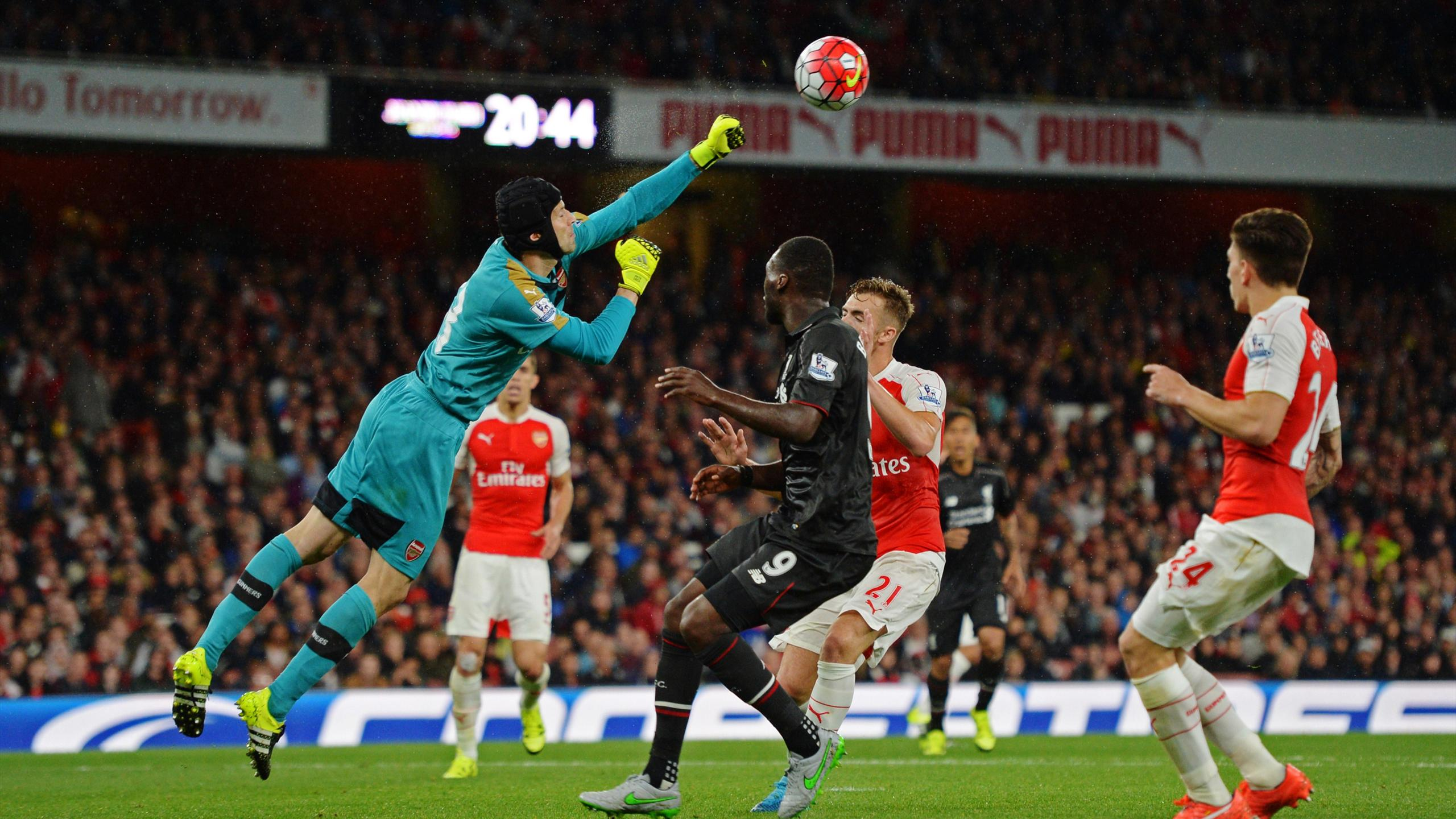 Arsenal's Petr Cech in action with Liverpool's Christian Benteke