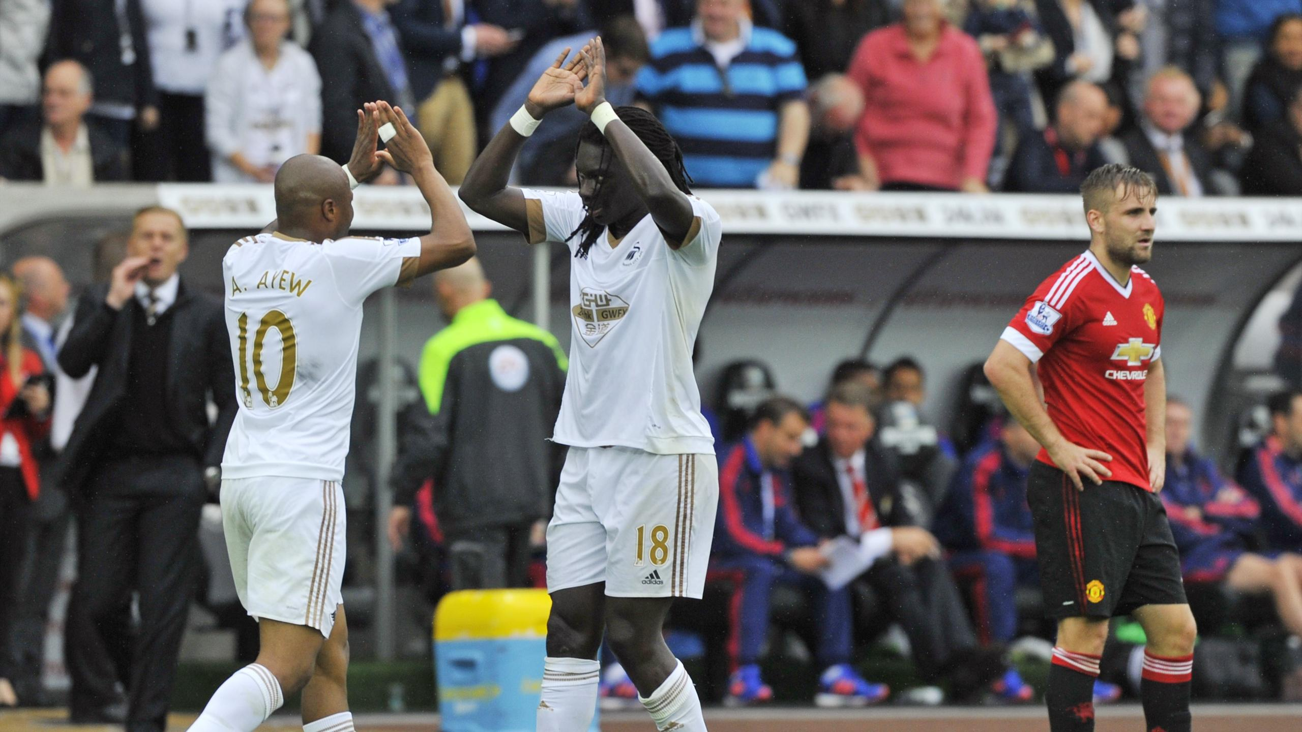 Bafetimbi Gomis celebrates with Andre Ayew after scoring the second goal for Swansea against Manchester United