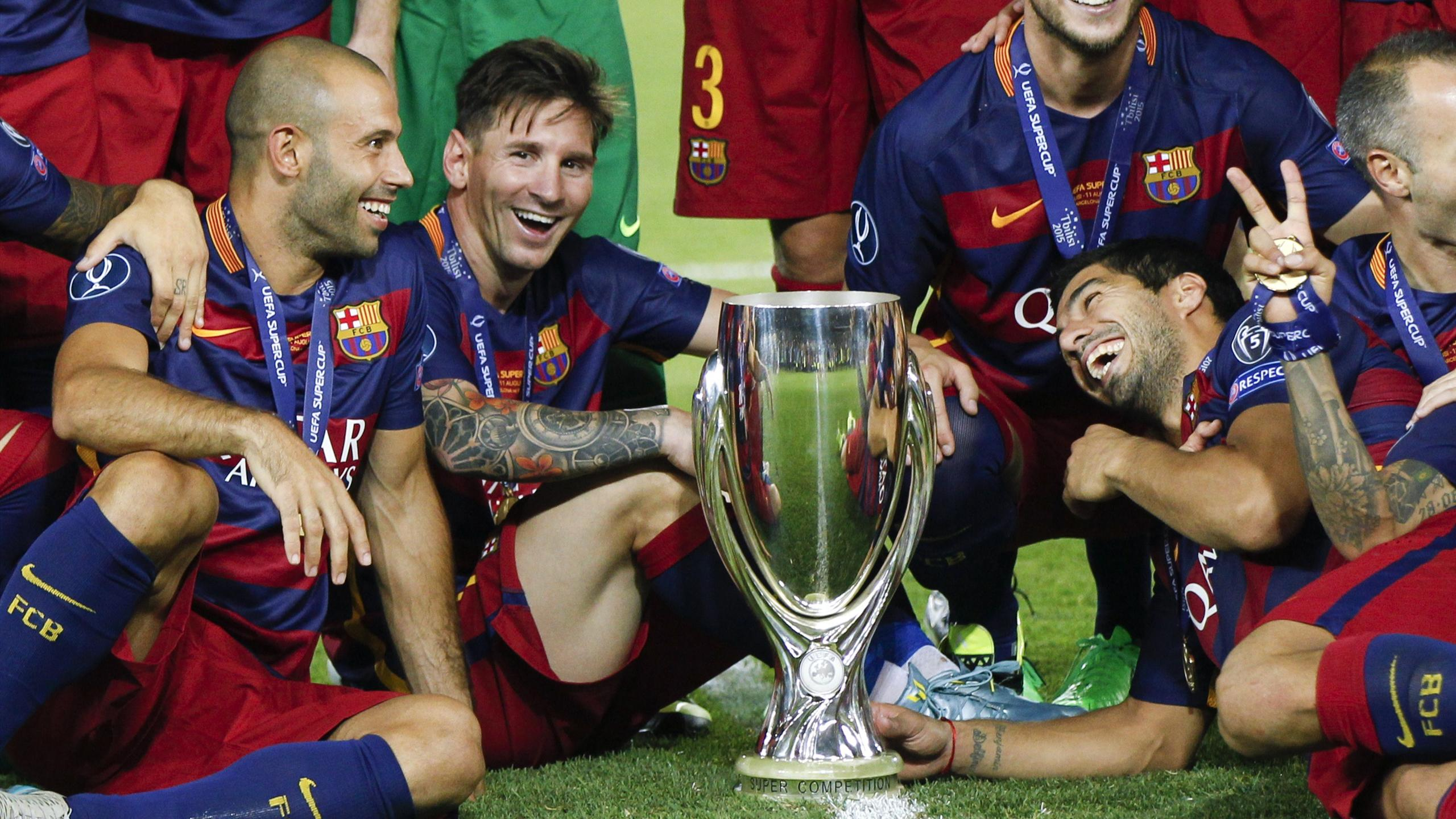 Lionel Messi and Javier Mascherano celebrate with other Barcelona players