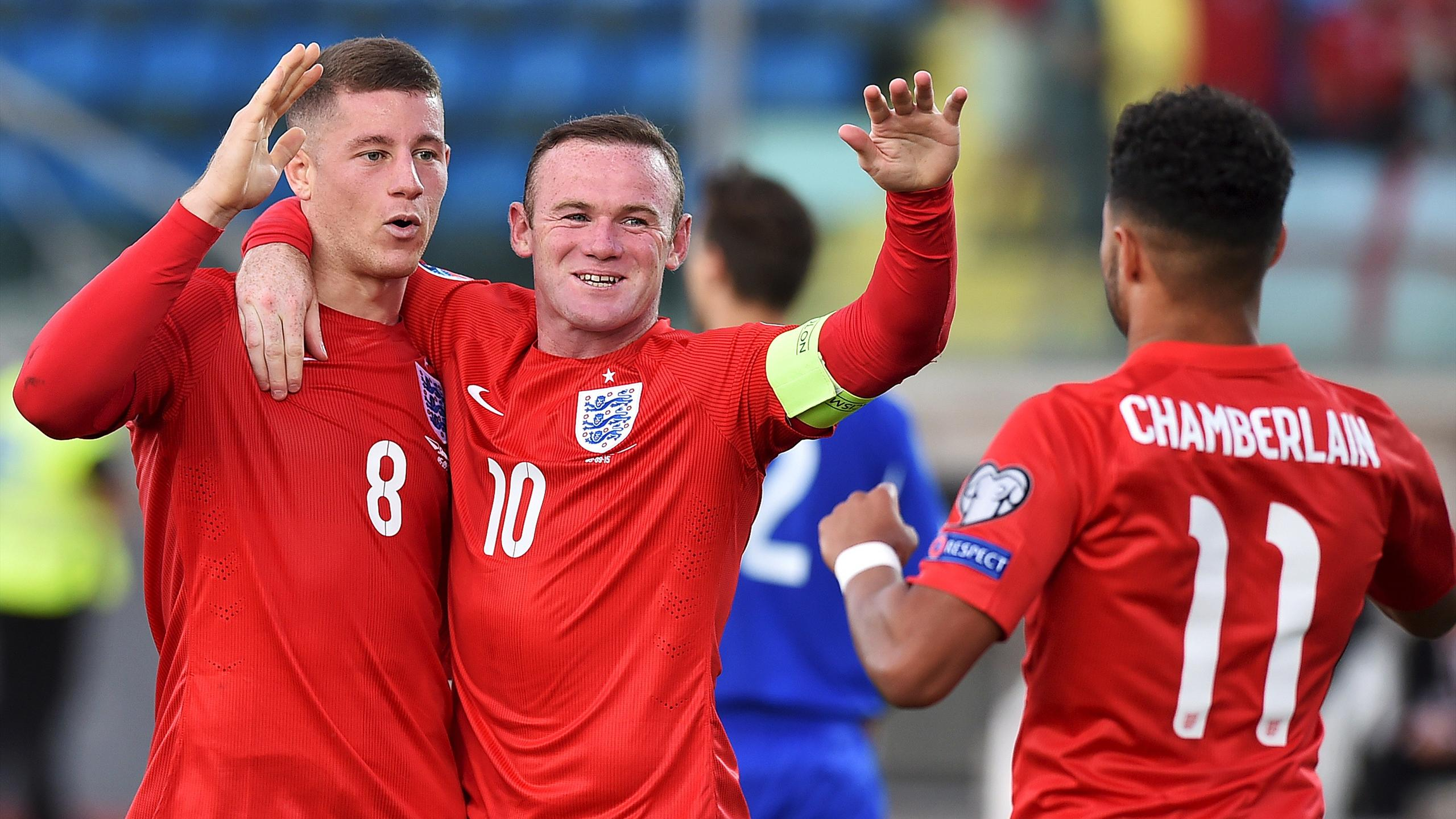 England's Ross Barkley (L) celebrates after scoring a goal with team mates Wayne Rooney (C) and Alex Oxlade-Chamberlain during their Euro 2016 qualifier against San Marino at the Olympic stadium in Serravalle