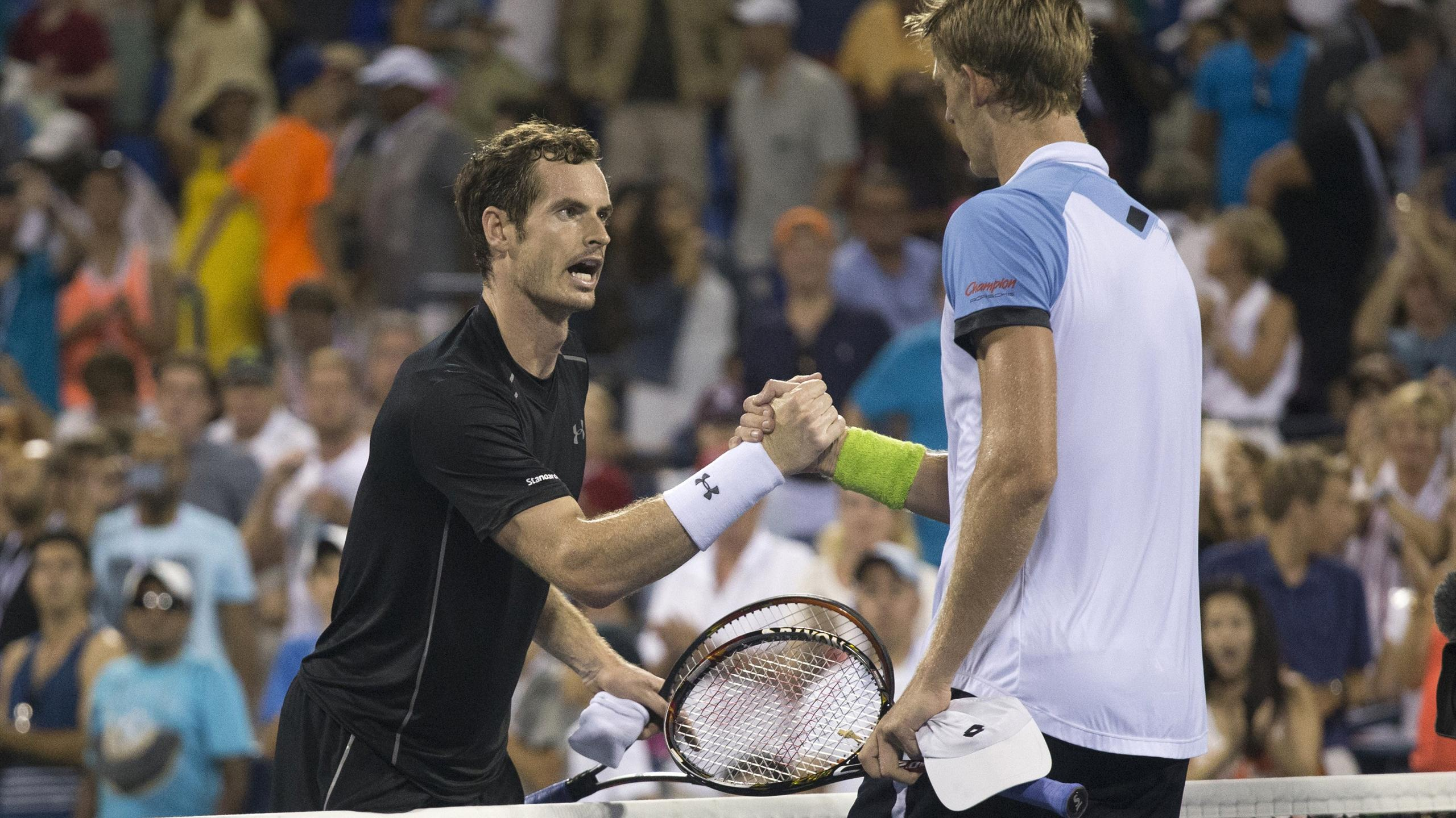 Andy Murray of Britain (L) greets Kevin Anderson of South Africa at the net after Anderson won their fourth round match at the U.S. Open Championships tennis tournament in New York