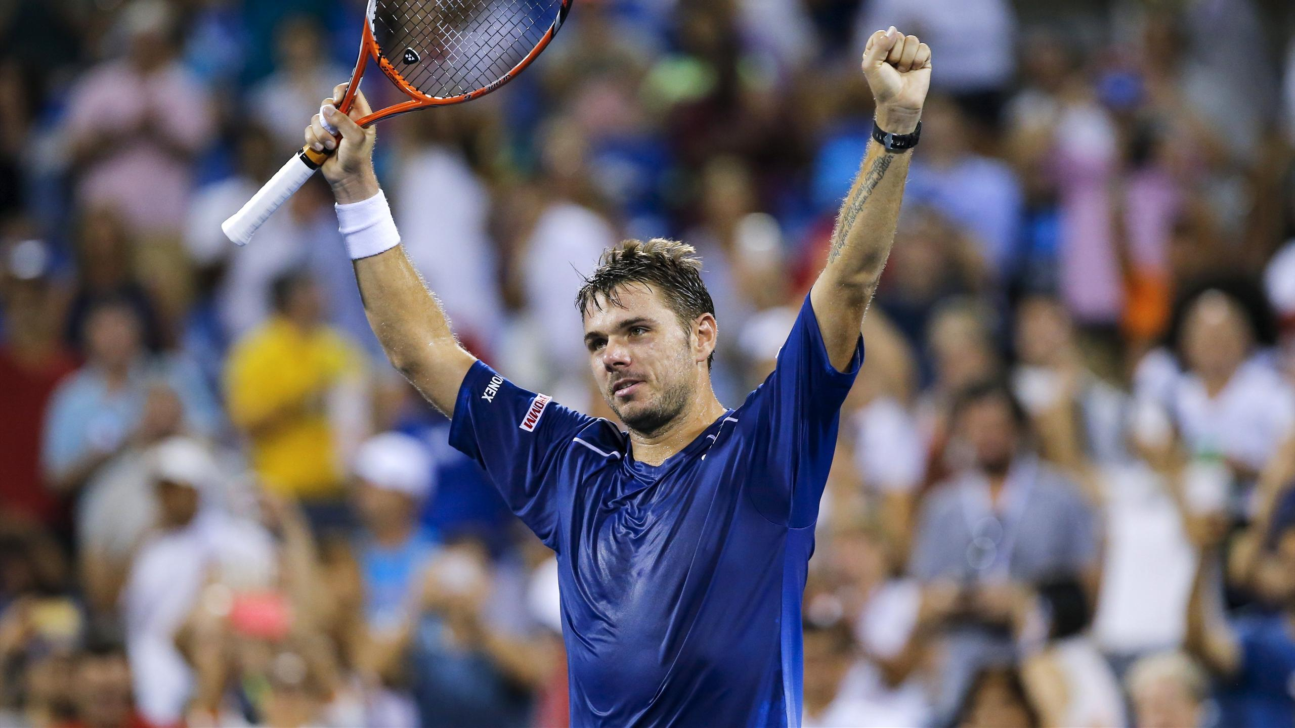 Stan Wawrinka of Switzerland celebrates his victory over Kevin Anderson of South Africa during their quarterfinals match at the U.S. Open Championships tennis tournament in New York