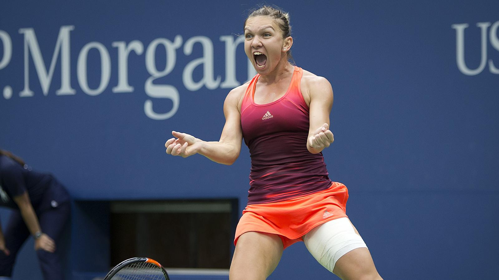 Simona Halep of Romania celebrates after defeating Victoria Azarenka of Belarus in their quarterfinals match at the U.S. Open Championships tennis tournament in New York