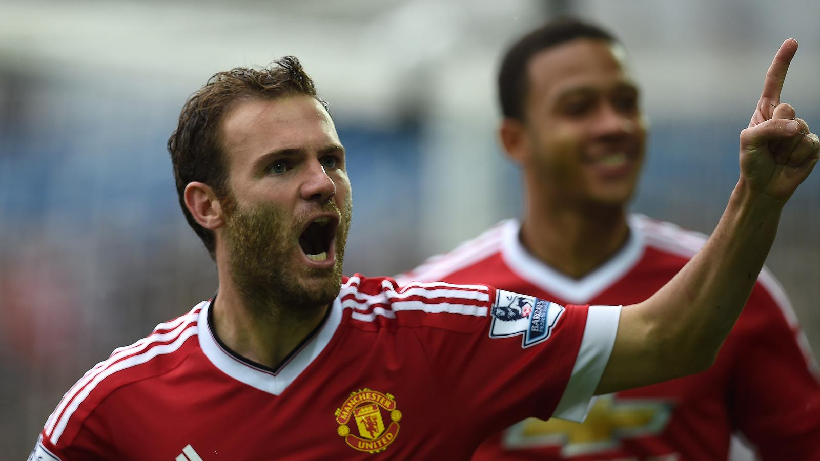Manchester United's Spanish midfielder Juan Mata (L) celebrates his goal after scoring during the English Premier League football match between Swansea City and Manchester United at The Liberty Stadium in Swansea, south Wales on August 30, 2015