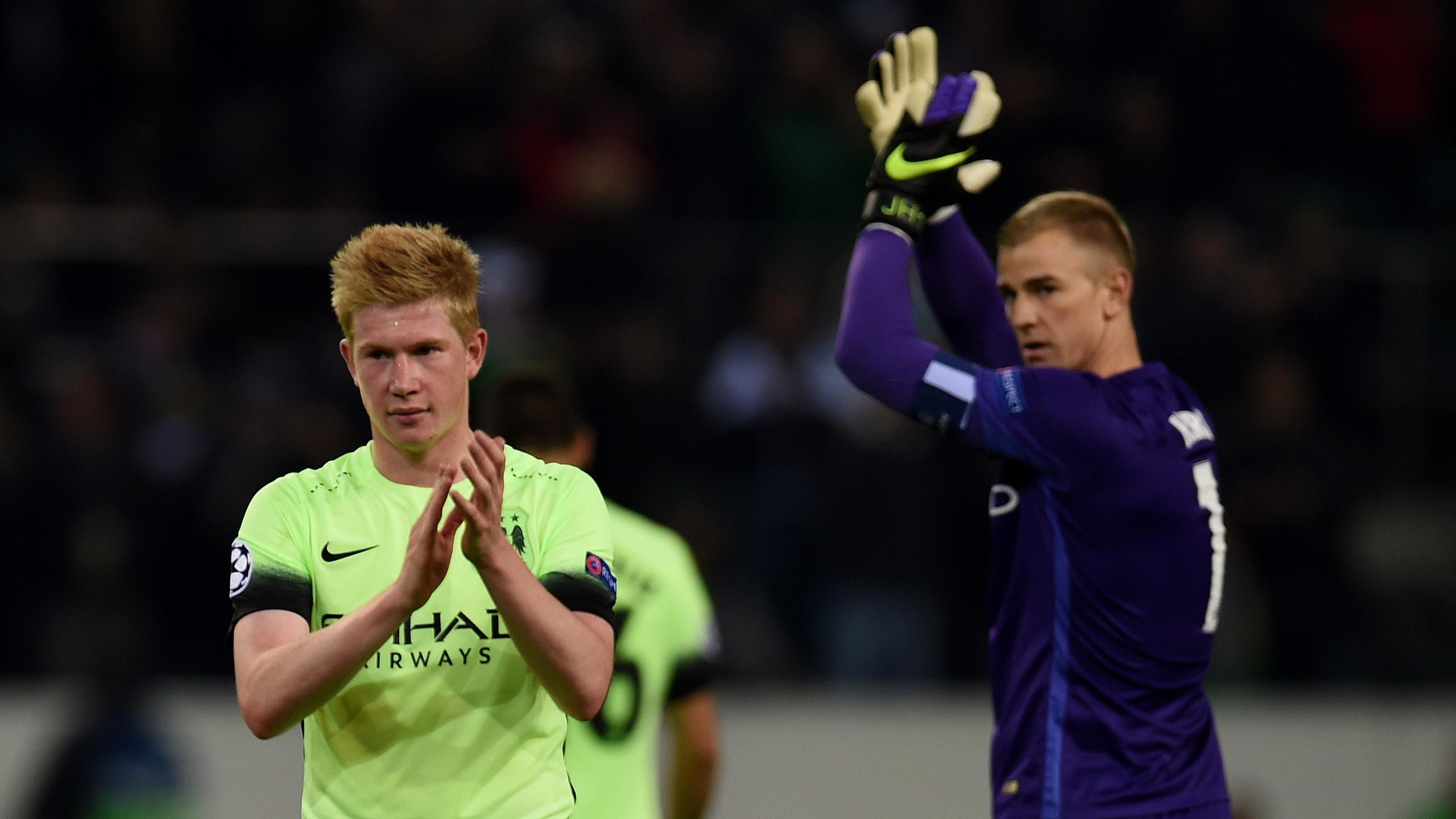 Manchester City's Belgian forward Kevin De Bruyne (L) and Joe Hart celebrate after the UEFA Champions League first-leg Group D football match between Borussia Monchengladbach and Manchester City in Monchengladbach, western Germany on September 30, 2015