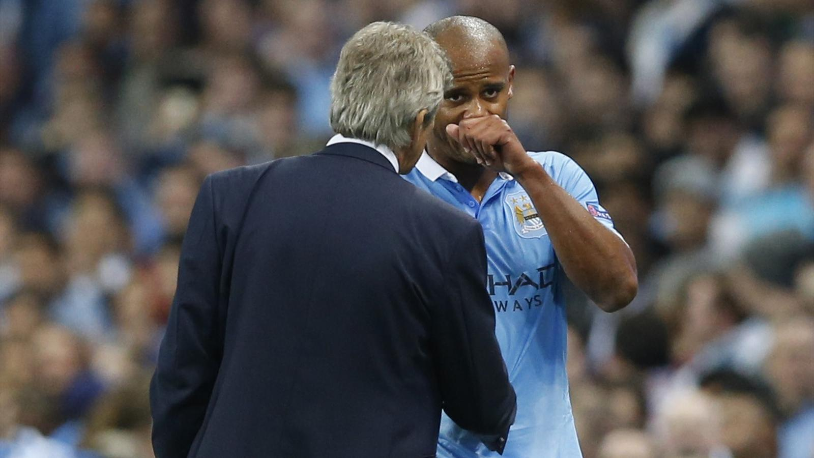 Manchester City's Vincent Kompany with manager Manuel Pellegrini
