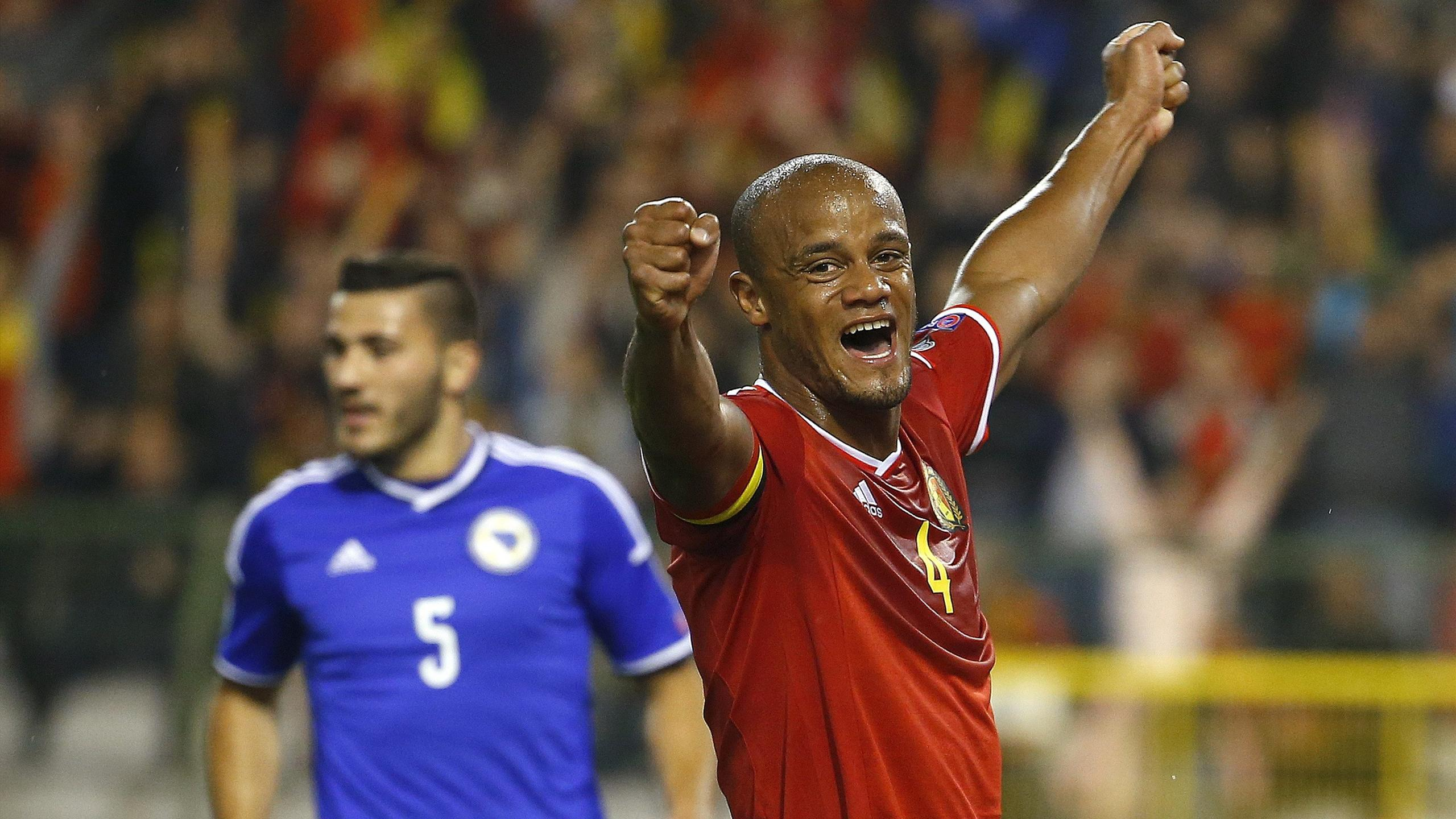 Belgium's Vincent Kompany (R) reacts