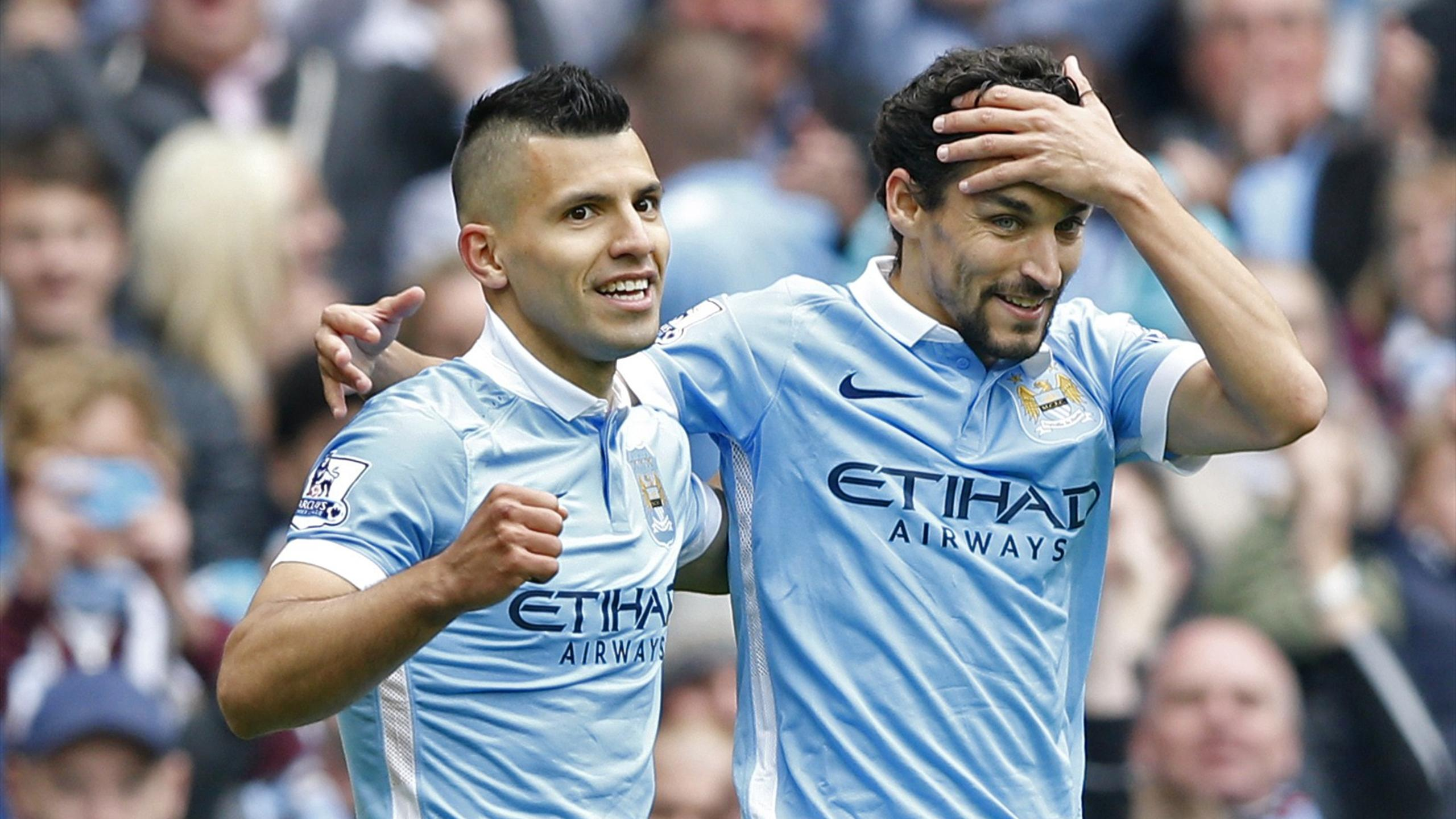 Sergio Aguero celebrates with Jesus Navas after scoring the third goal for Manchester City and completing his hat trick