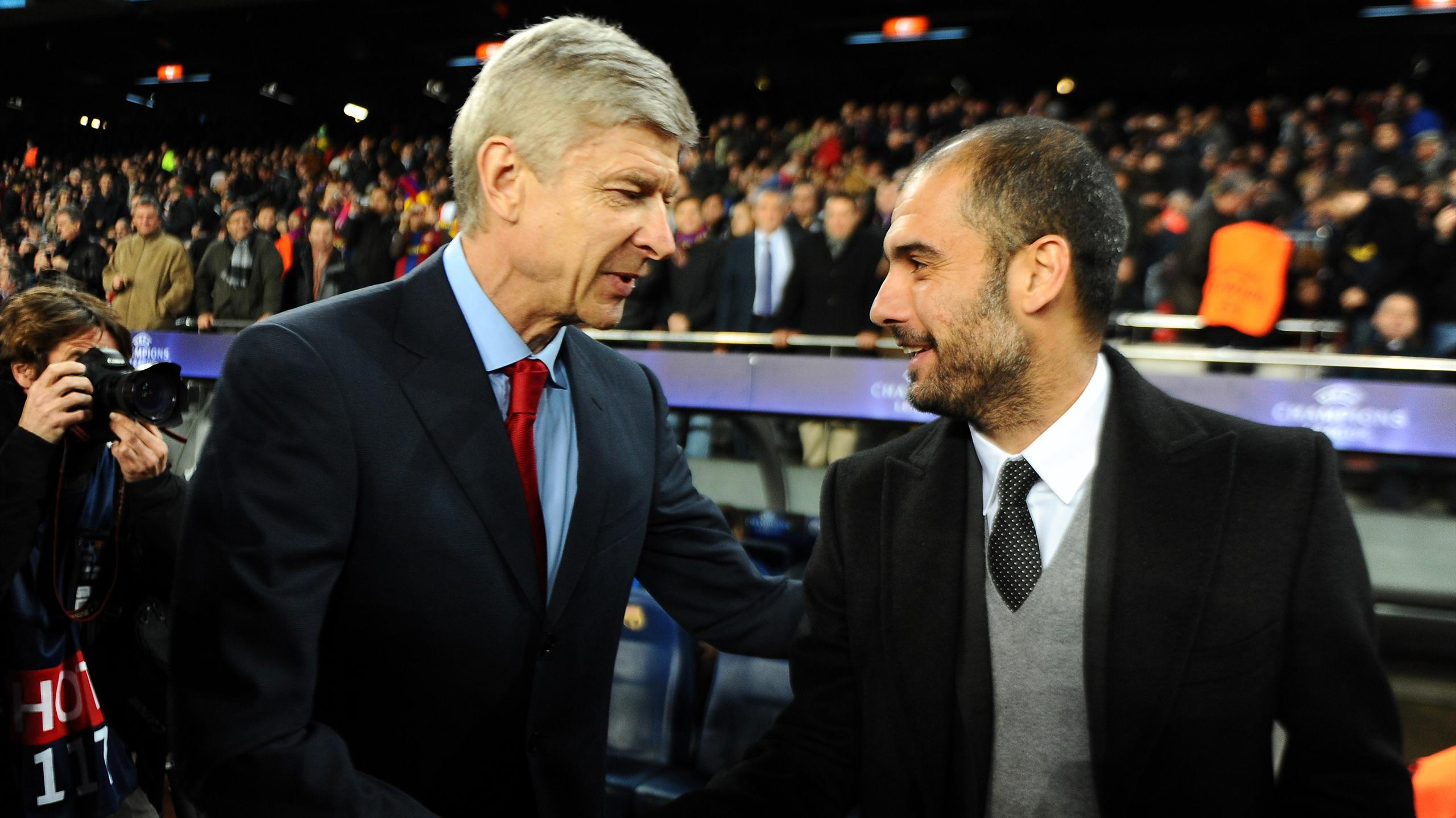 Barcelona's coach Pep Guardiola (R) welcomes Arsenal's French coach Arsène Wenger (L) before the Champions League