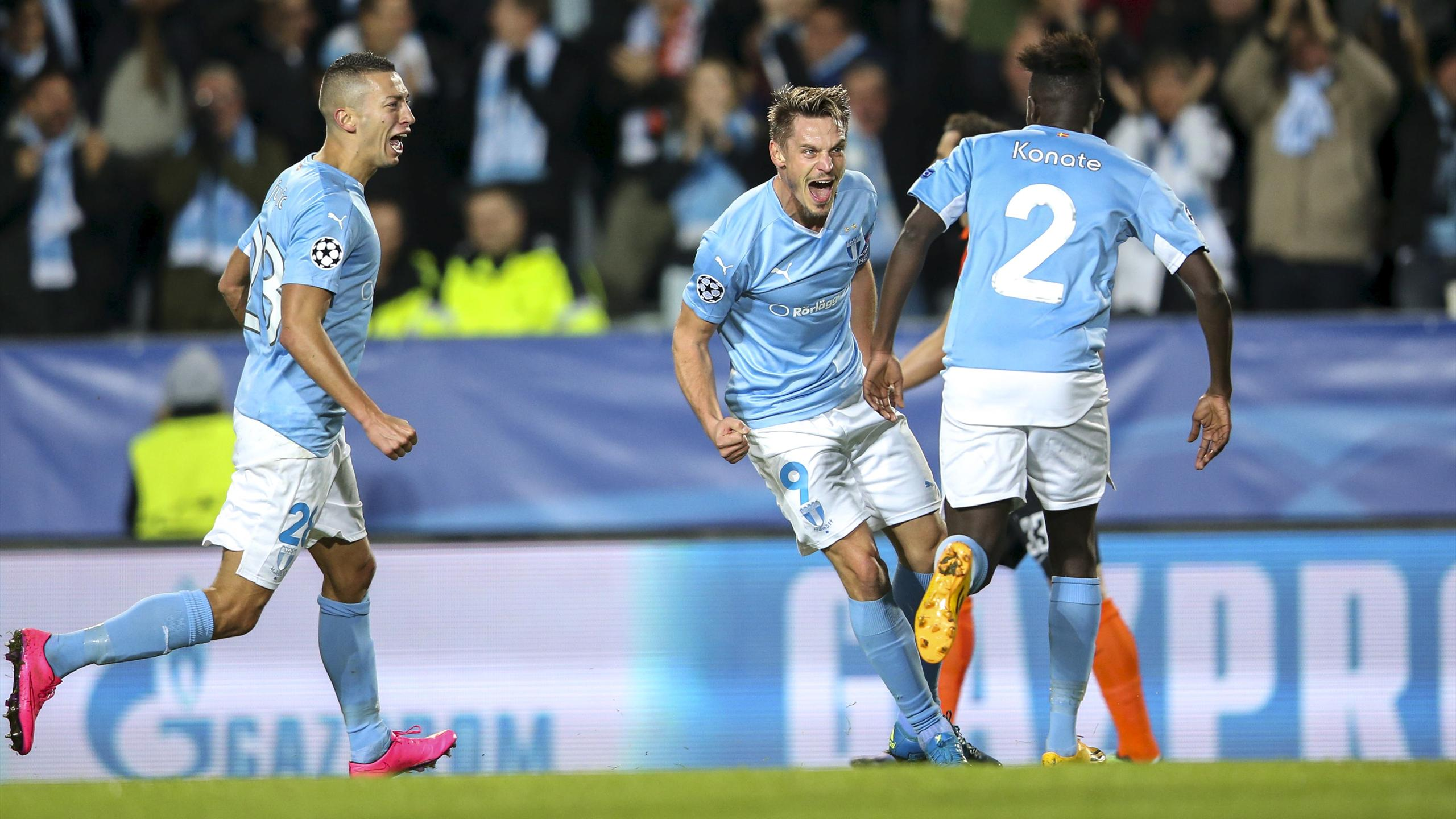Malmo's Markus Rosenberg (C) celebrates with his teammates after scoring the opening goal during their Champions League Group A soccer match against Shakhtar Donetsk