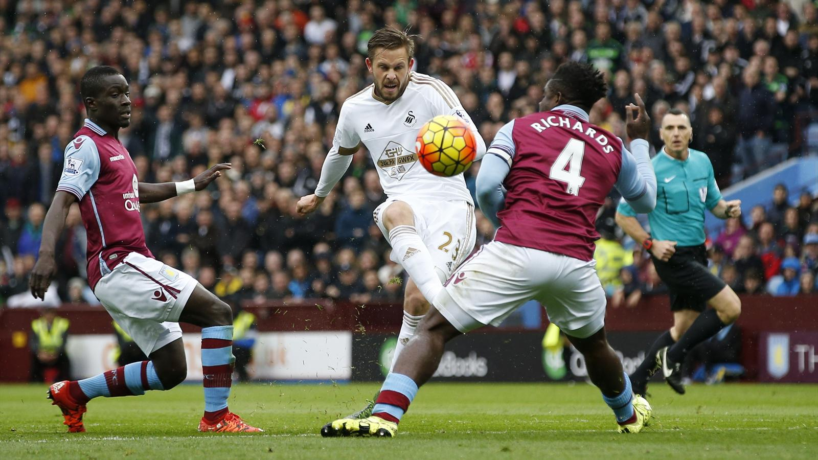 Aston Villa's Micah Richards confronts Gylfi Sigurdsson on Swansea